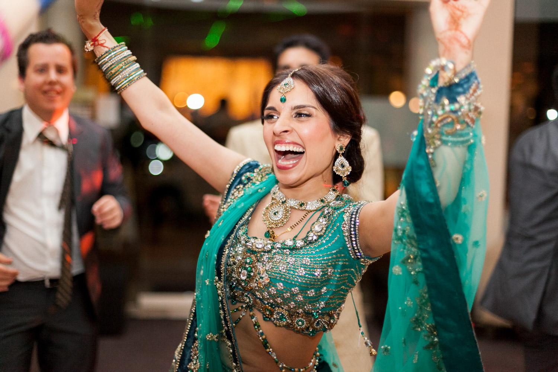 wedding-0404-indian-reception-dancing-green-sari-queensland.jpg