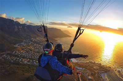 Paragliding in the clouds above the majestic Cape Town. Enjoy a truly unique perspective of the landscapes below.