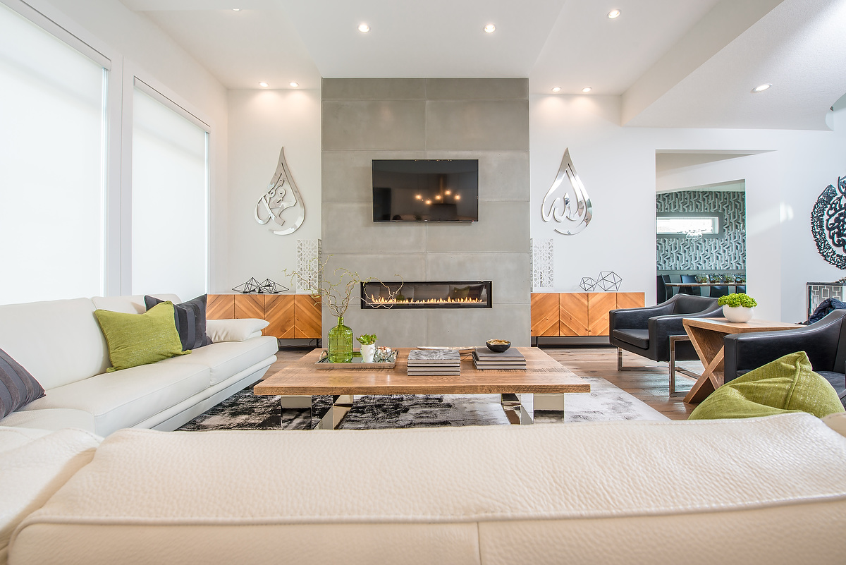 This room is where family gathers together and guests experience the style of the home first hand. The seating arrangement is designed to entertain large gatherings, while also accommodating relaxing nights in watching a favourite show!