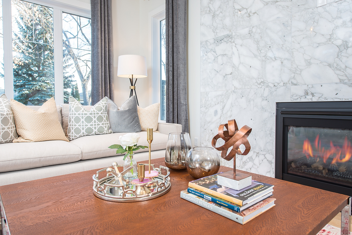 Natural materials like marble and copper compliment the soft tones and warm coloured wood in this living room.