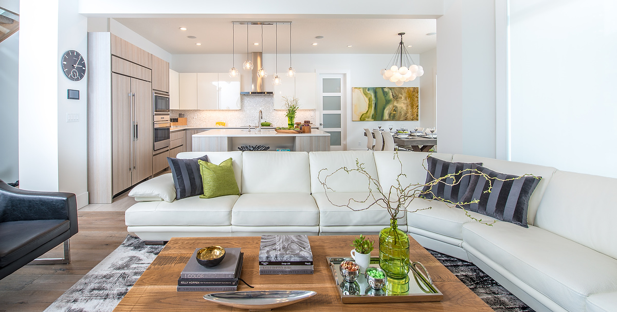 The bright, spacious kitchen flows seamlessly from the living area and includes a table for six.