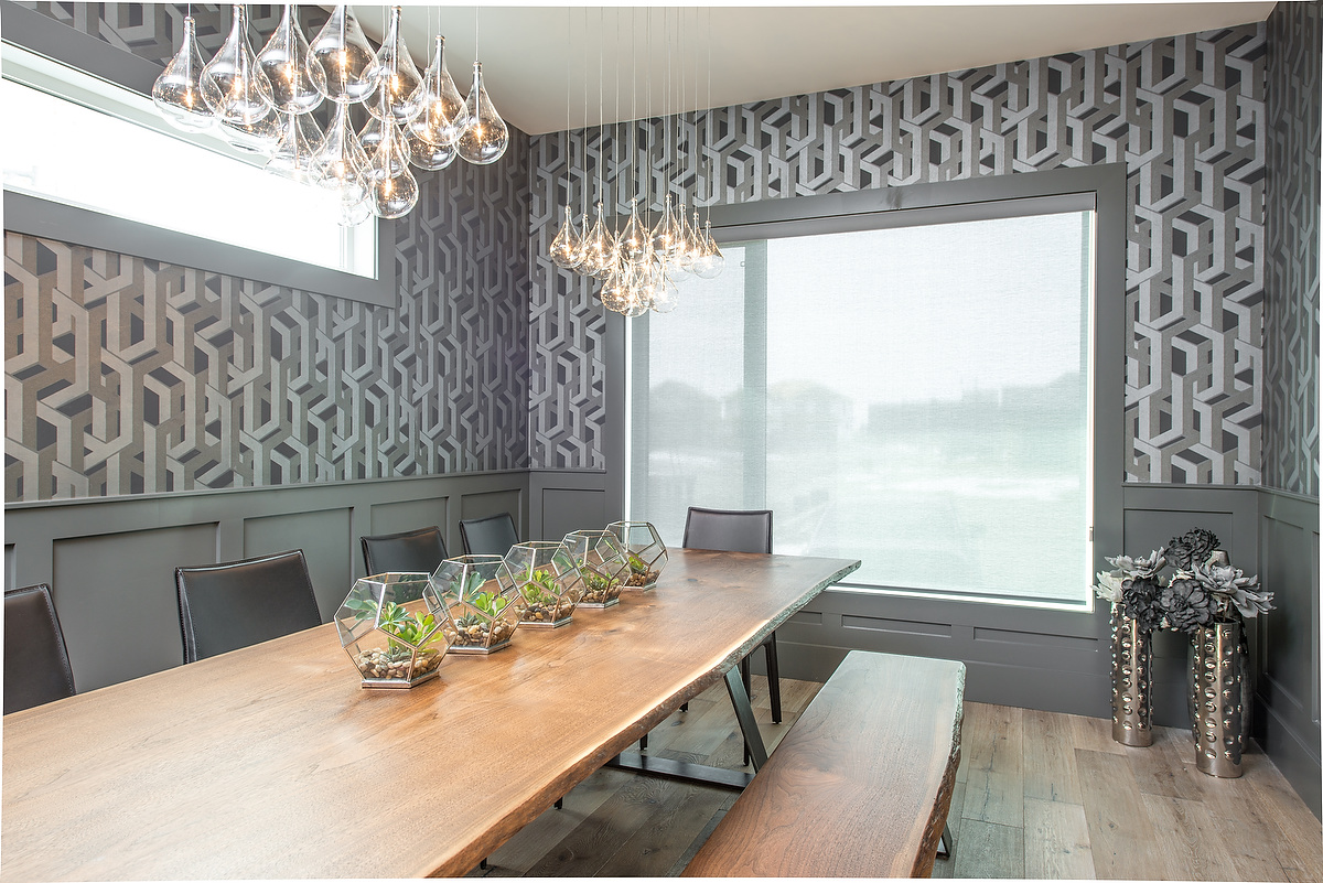 Bold wall finishes and clustered light fixtures add to the drama of the formal dining room.