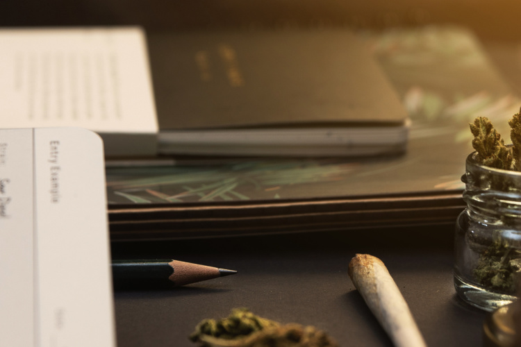 pencil and joint with cannabis journal
