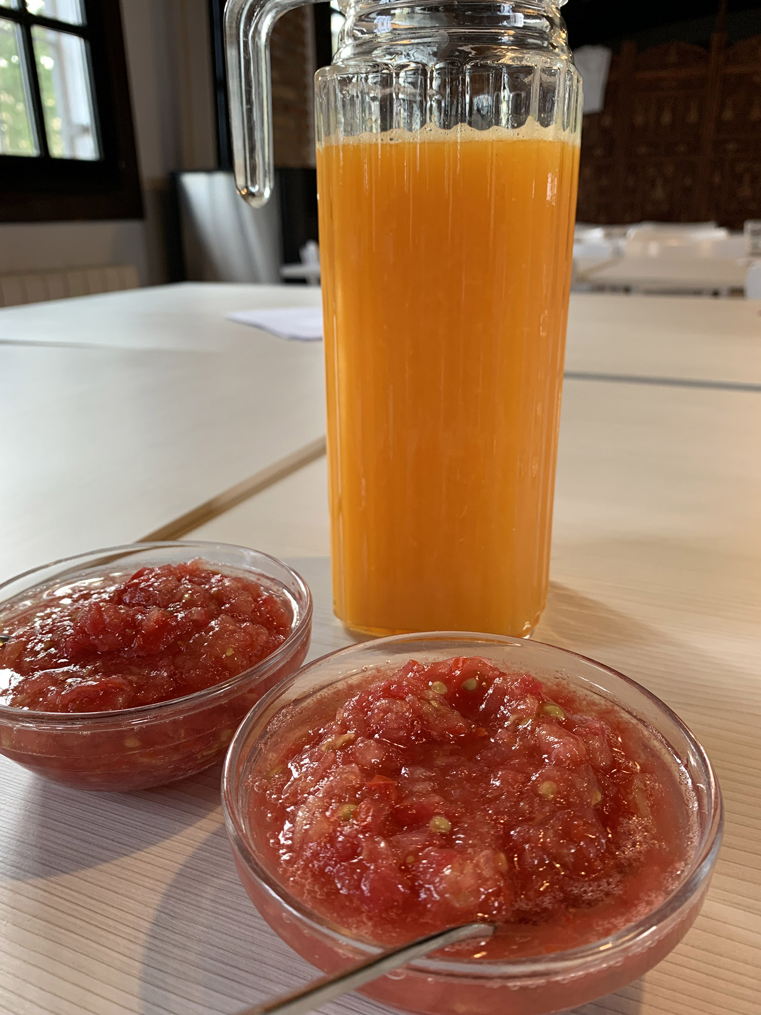 Freshly squeezed orange and grated tomato for breakfast