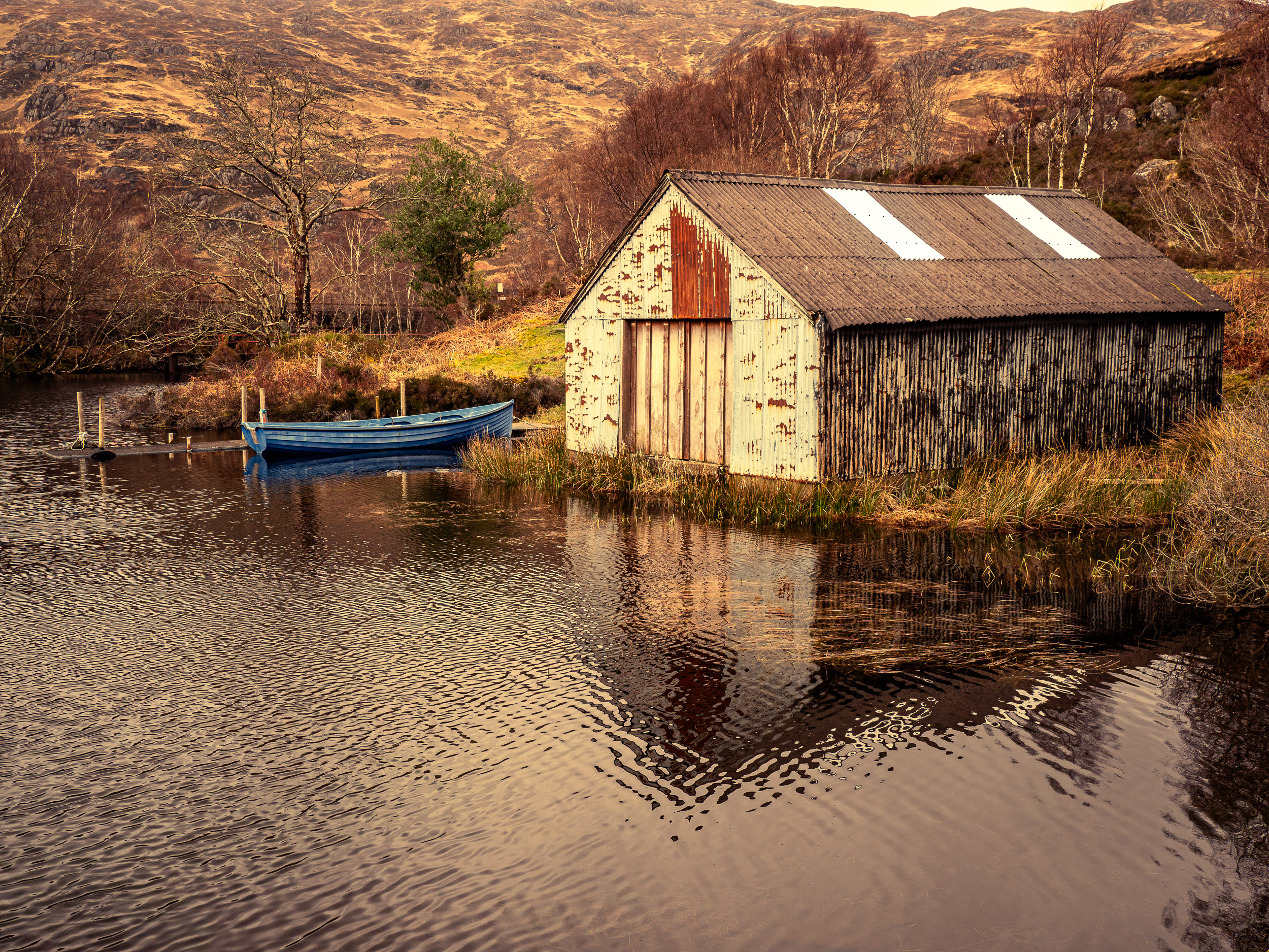A Boat shed at Loch Eilt - These photographs were made in March 2019 on a workshop with Garry Brannigan.The loch is narrow and laid out on an east-west axis. The railway between Glenfinnan and Mallaig skirts the southern shore.On this occasion on an afternoon of spring sunshine I happened upon a boat shed at the western end of the loch. The thought occurred to me that few of the railway passengers would look in this direction given that they had just experienced the Harry Potter moment looking to the south.