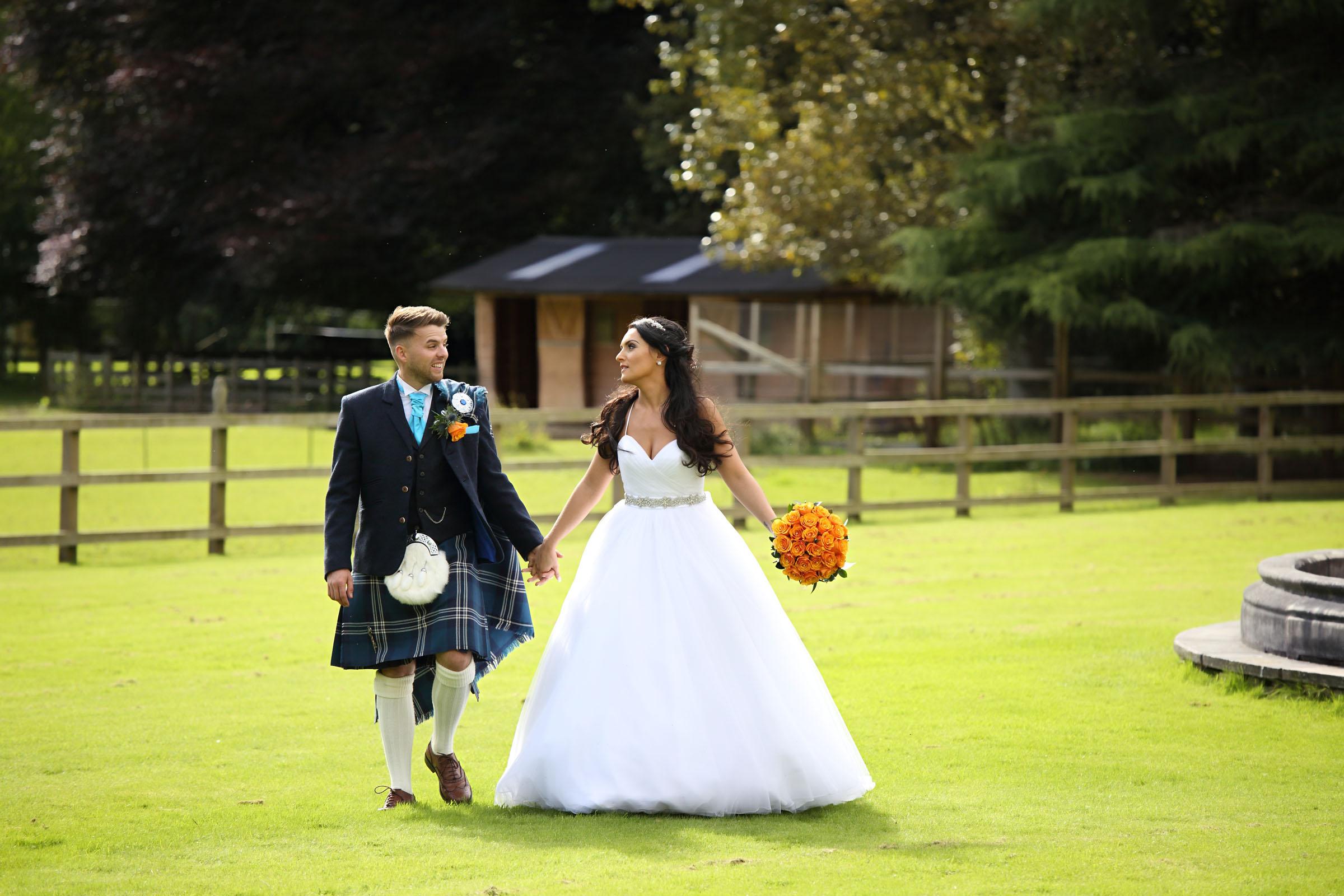 Bride_and_Groom_walk_wedding photographer.jpg