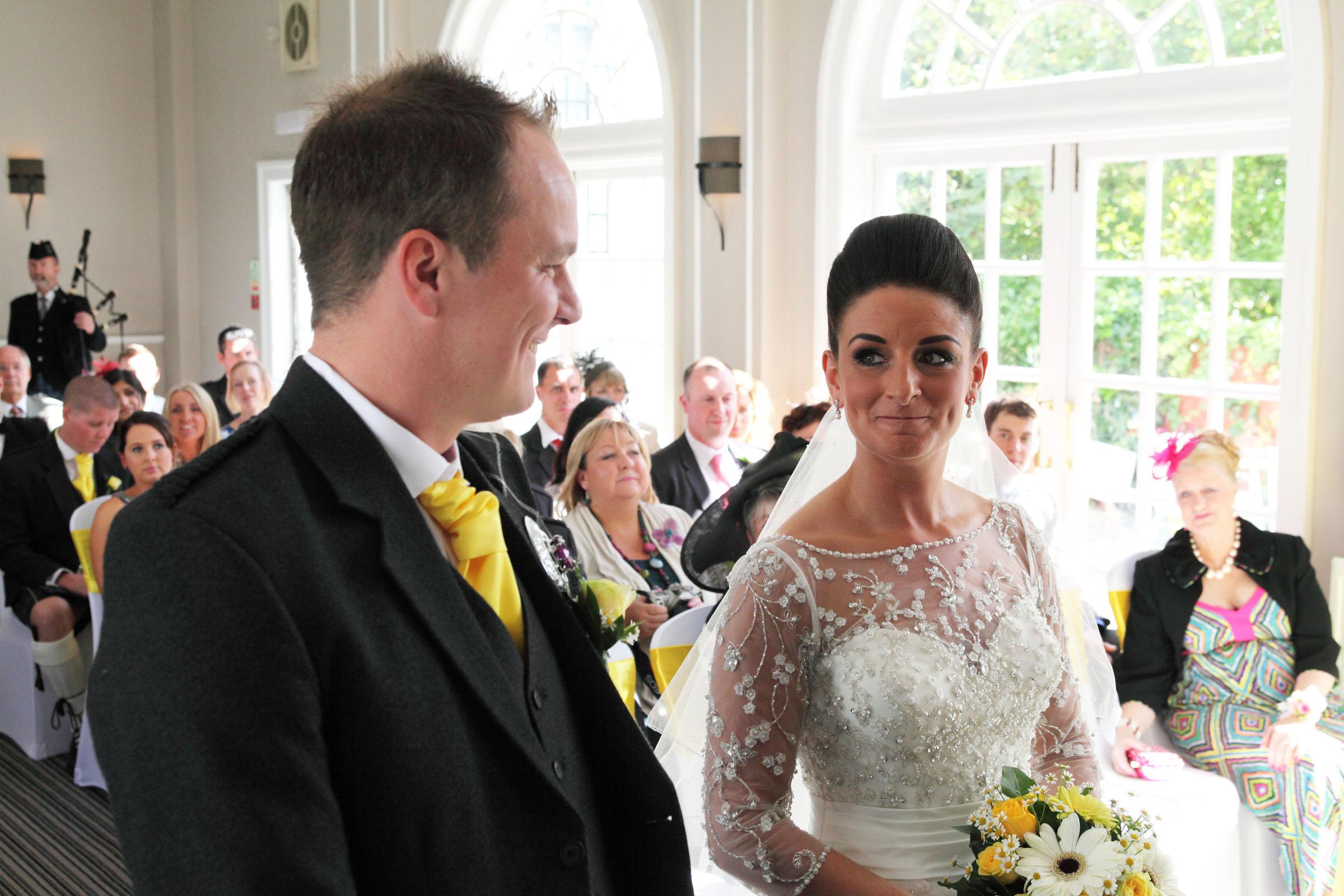 Bride_looks_at_groom.jpg