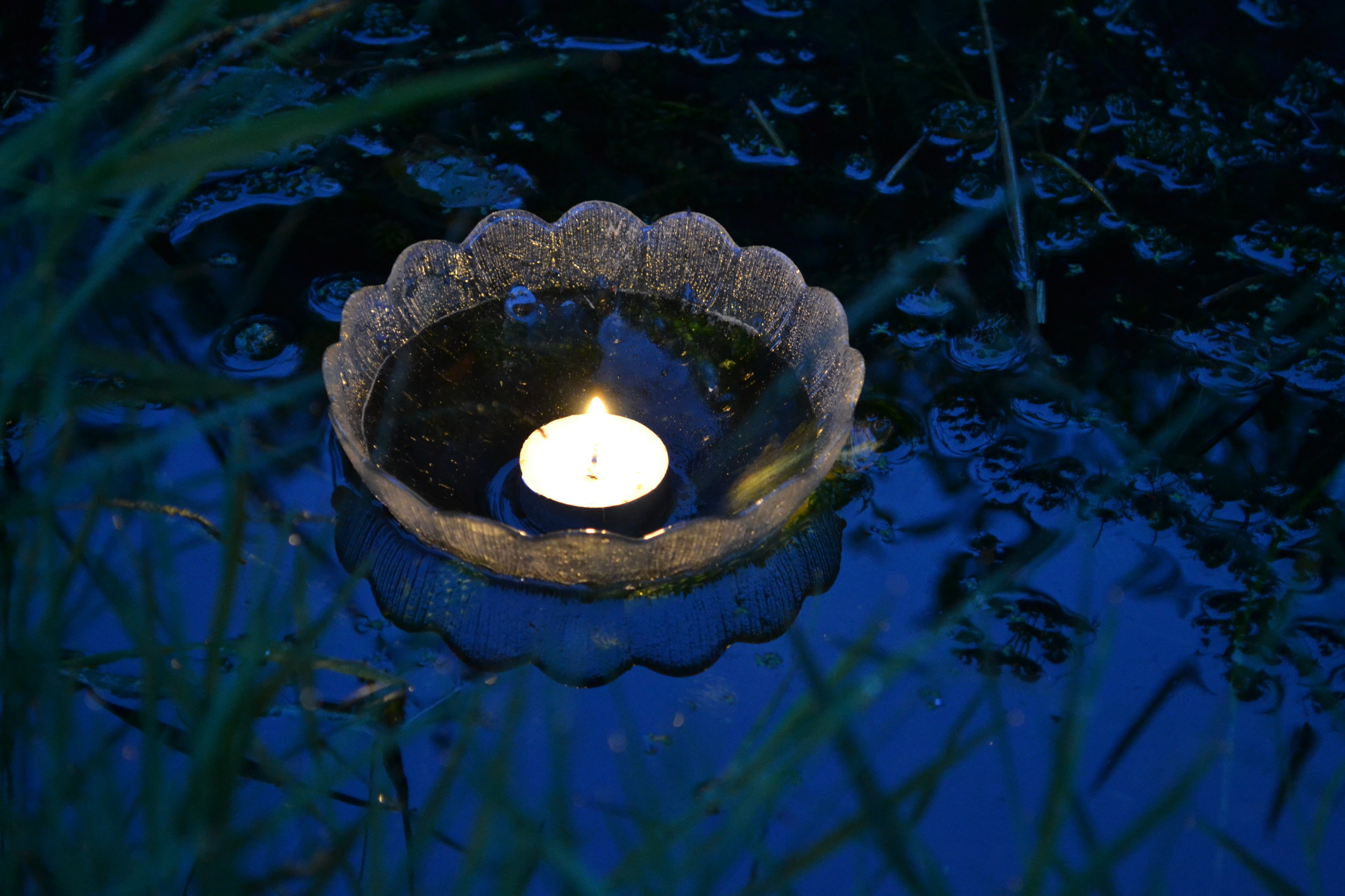 Candles on the pond