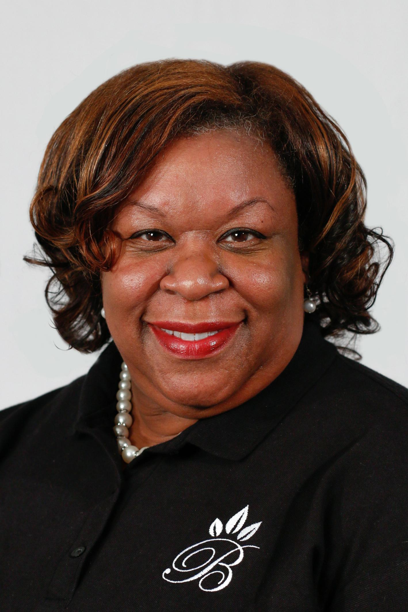 Trina White,   Dollars + Sense Support Staff