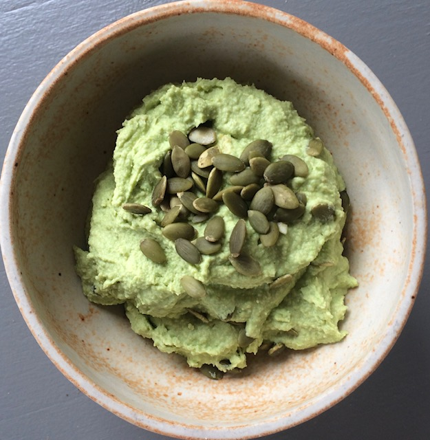 """""""Edamame Hummus"""". . .I put equal parts of Garbanzo Beans and defrosted Edamame Beans in a food processor (bags of Edamame Beans may be found in the frozen vegetable aisle). Then I add the juice of one large lemon and about 1/3 cup of the liquid drained from the Garbanzo Beans, along with 3 cloves of garlic (diced), and 1 tablespoon of Mrs. Dash Southwest Chipotle seasoning. You may add Tahini or a ripe avocado, but I like to keep my hummus fat-free and add nuts or seeds for garnish instead."""