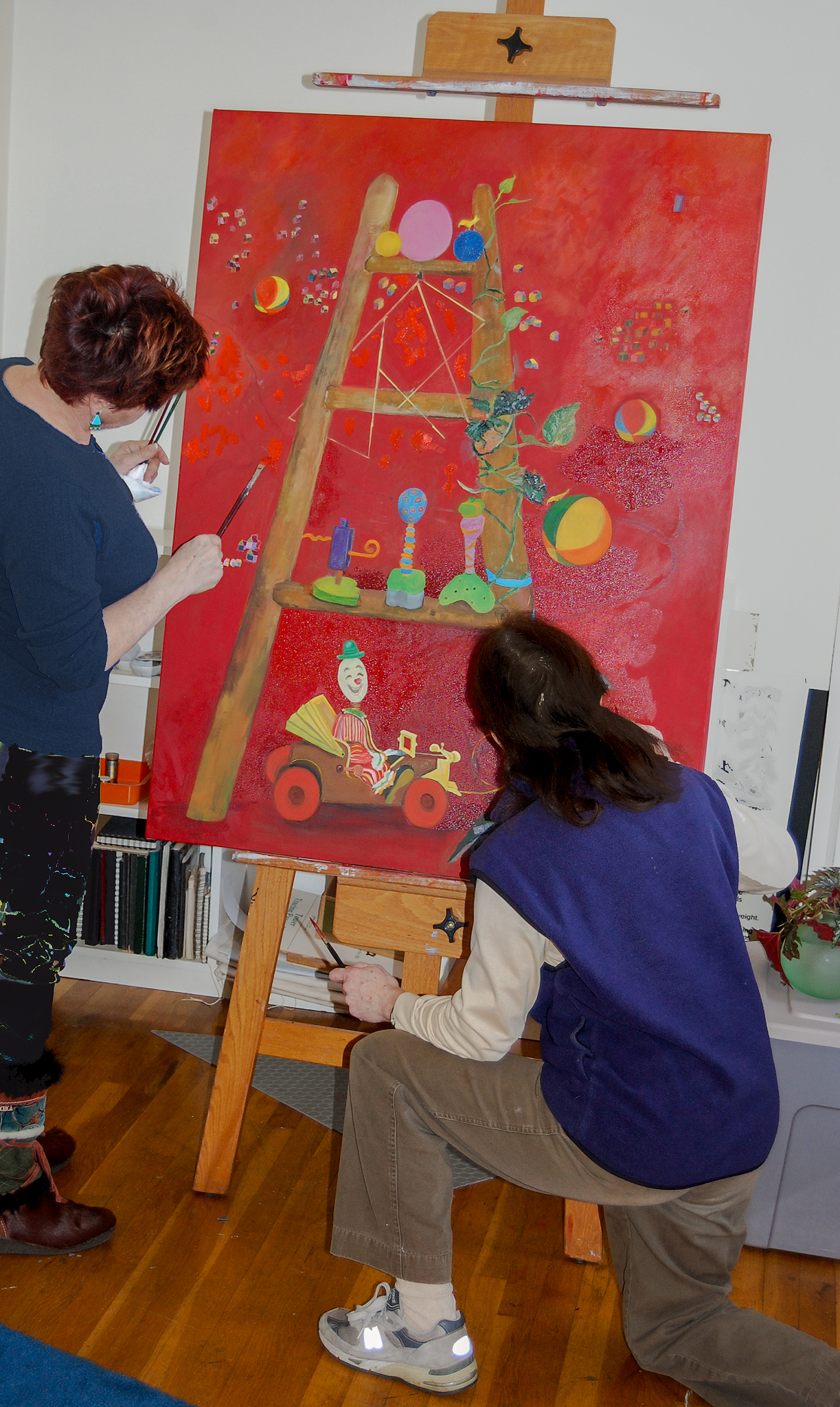 """Harriet (left) and Abbe working on """"Big Red"""""""