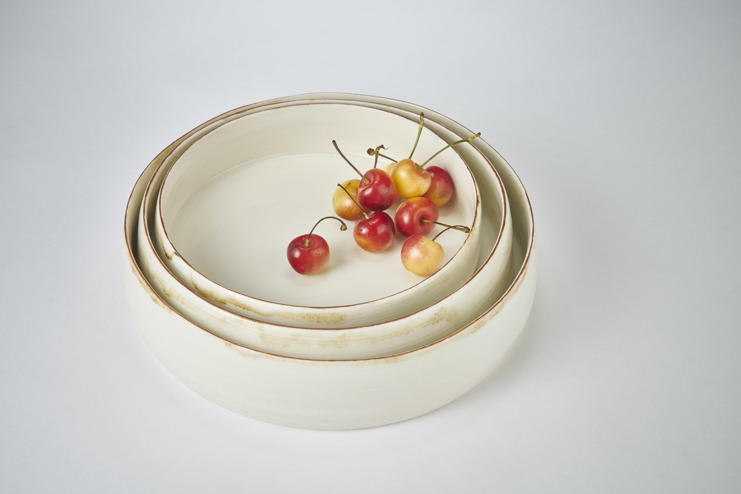 K Adams Ceramics nest of bowls with bronze lustre rim small 20cm x 5cm, medium 22cm x 5.5cm, large 25.5cm x 6cm. Photography Matthew Booth.jpg