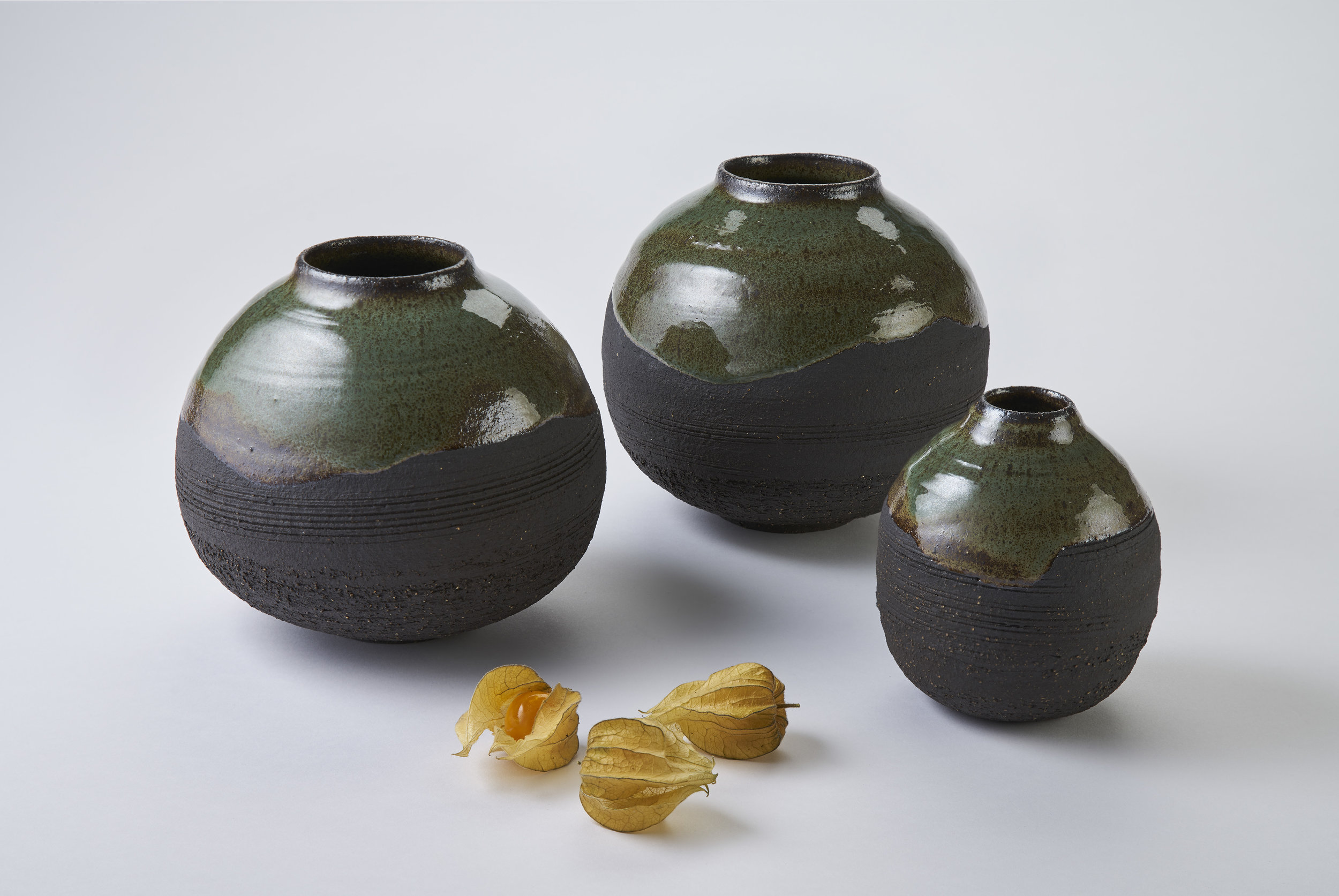 K A Ceramics Black stoneware moon jars, copper green gloss. Medium 6cm x 16cm, small 3cm x 12.5cm. Matthew Booth Photography.jpg