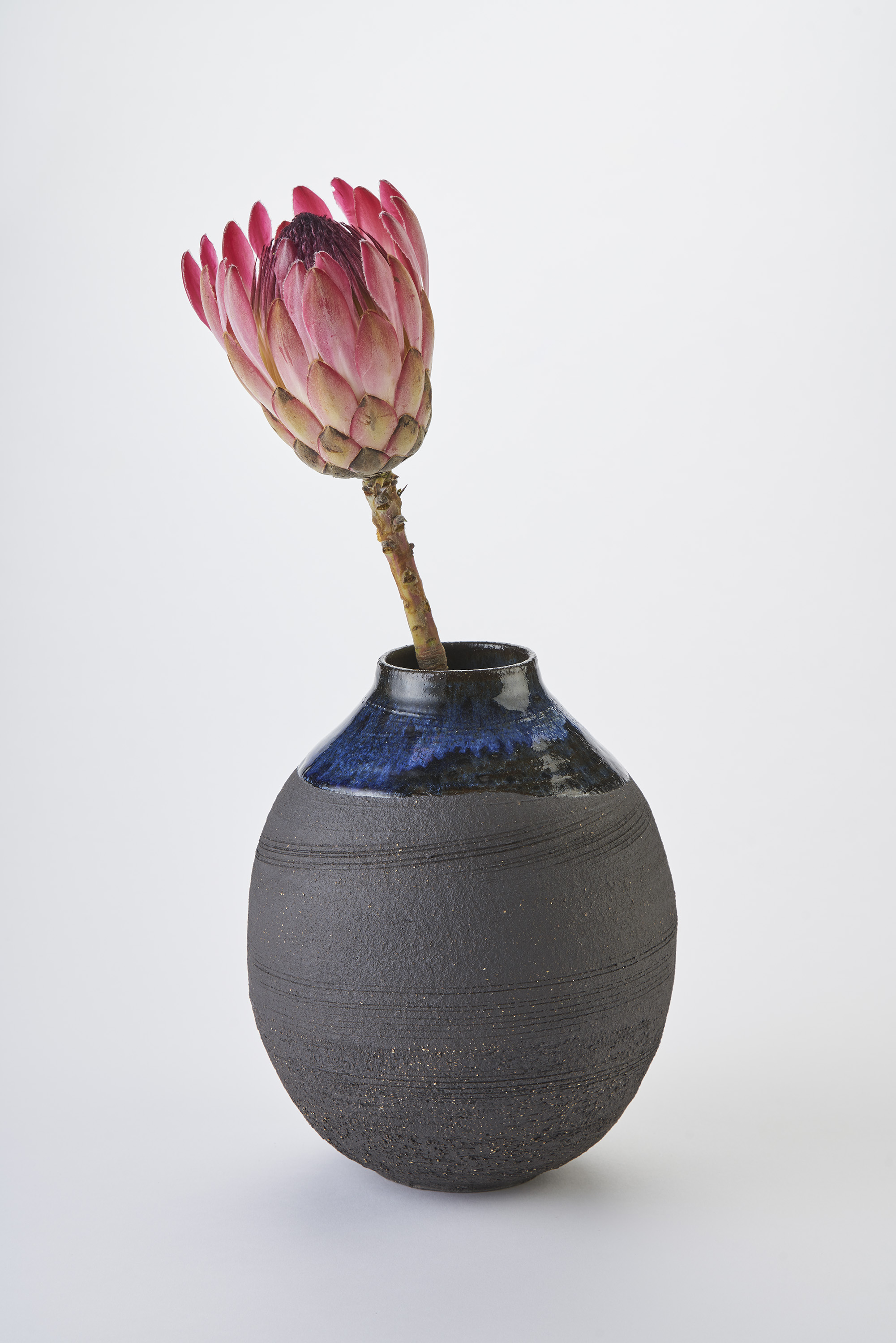 KA Ceramics Large moon jar in Textured black stoneware with cobalt gloss and dolomite and tin glazes 6cm x 23.5cm, Matthew Booth Photography.jpg
