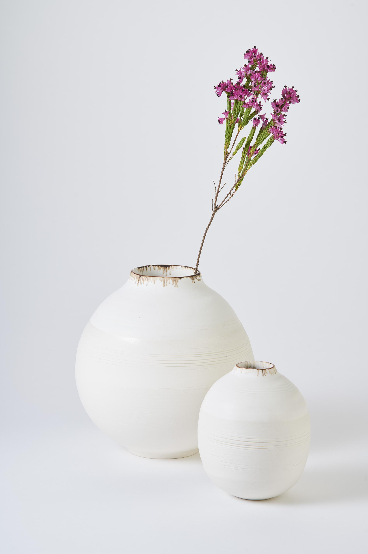 KA Ceramics Porcelain moon jars, dolomite and tin,  bronze and oxide rim. Medium 6cm x 18cm, small 3.5cm x 11.5cm. Matthew Booth photography  1.jpg