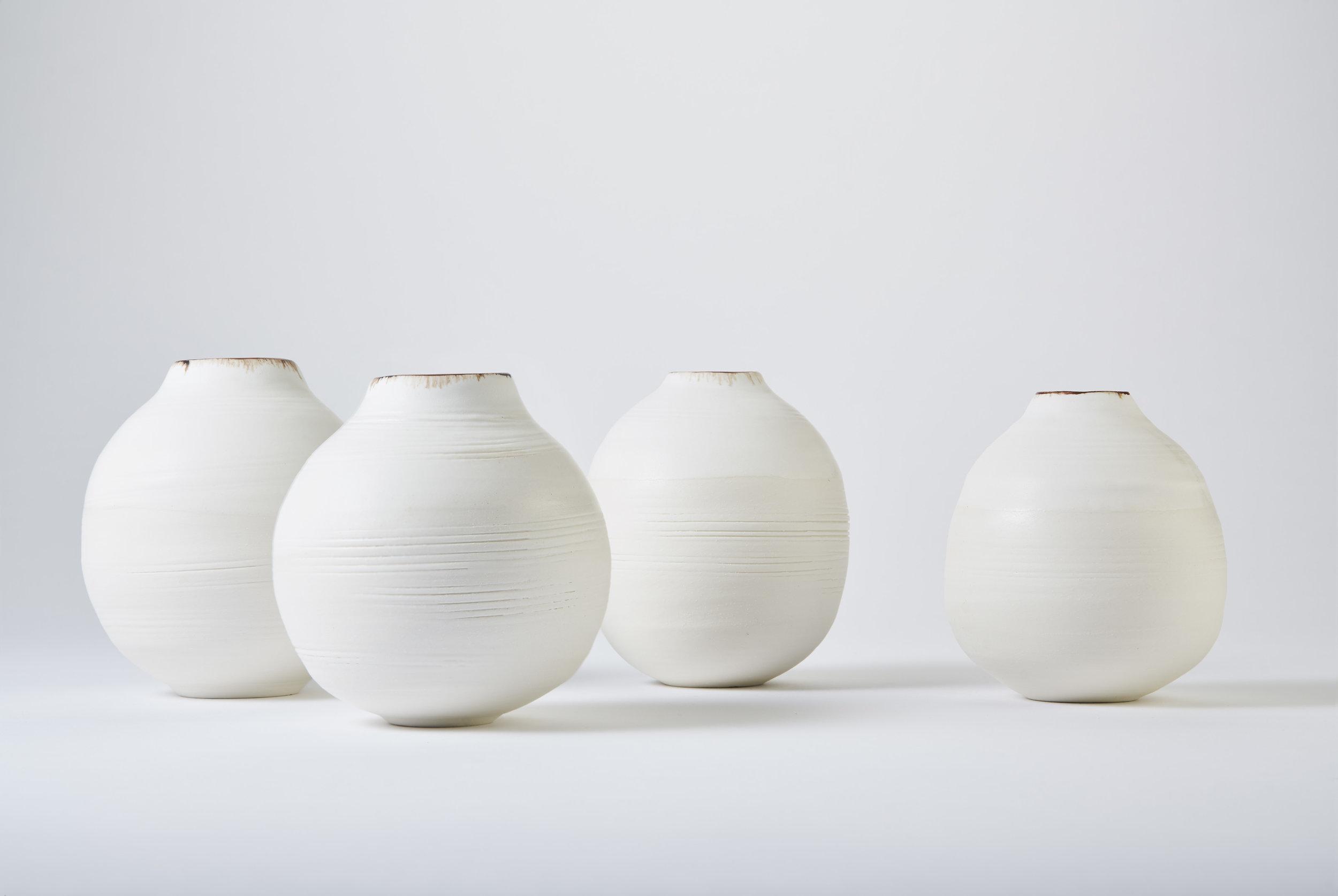 KA Ceramics Porcelain moon jars, dolomite and tin, bronze and oxide rim. Small 3.5cm x 11.5cm and 3cm x 11cm. Matthew Booth photography.jpg