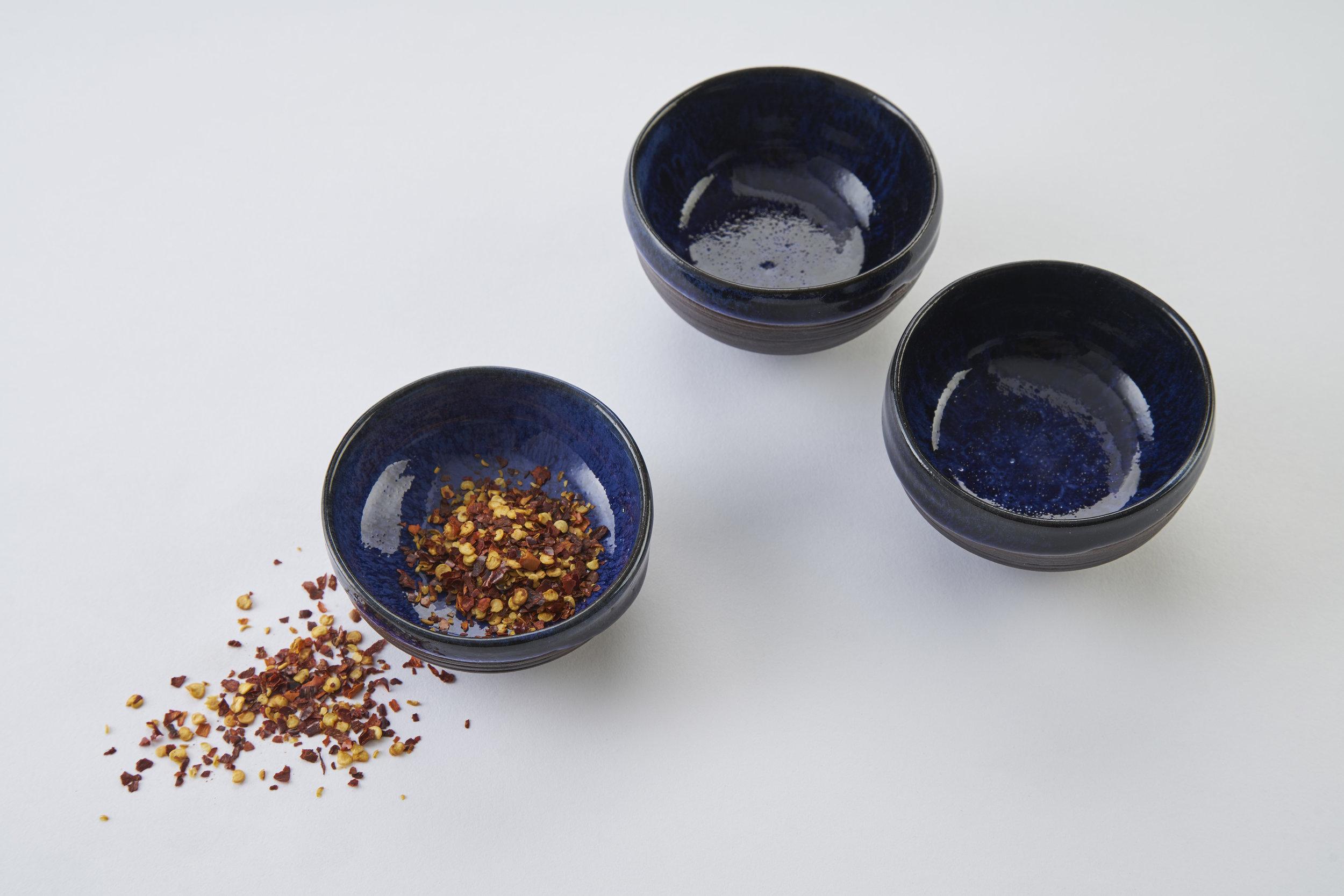 KA Ceramics Black Onyx porcelain salt bowls (7.5cm x 4cm) and chilli bowls (3cm x 7cm) cobalt blue, dolomte and tin layered glaze. Matthew Booth photography 1.jpg