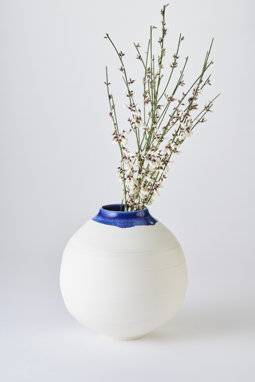 KA Ceramics Porcelain medium moon jar with blue inside and blue:dol and tin on rim 5.5cm x 17cm. Matthew Booth Photography 1.jpg