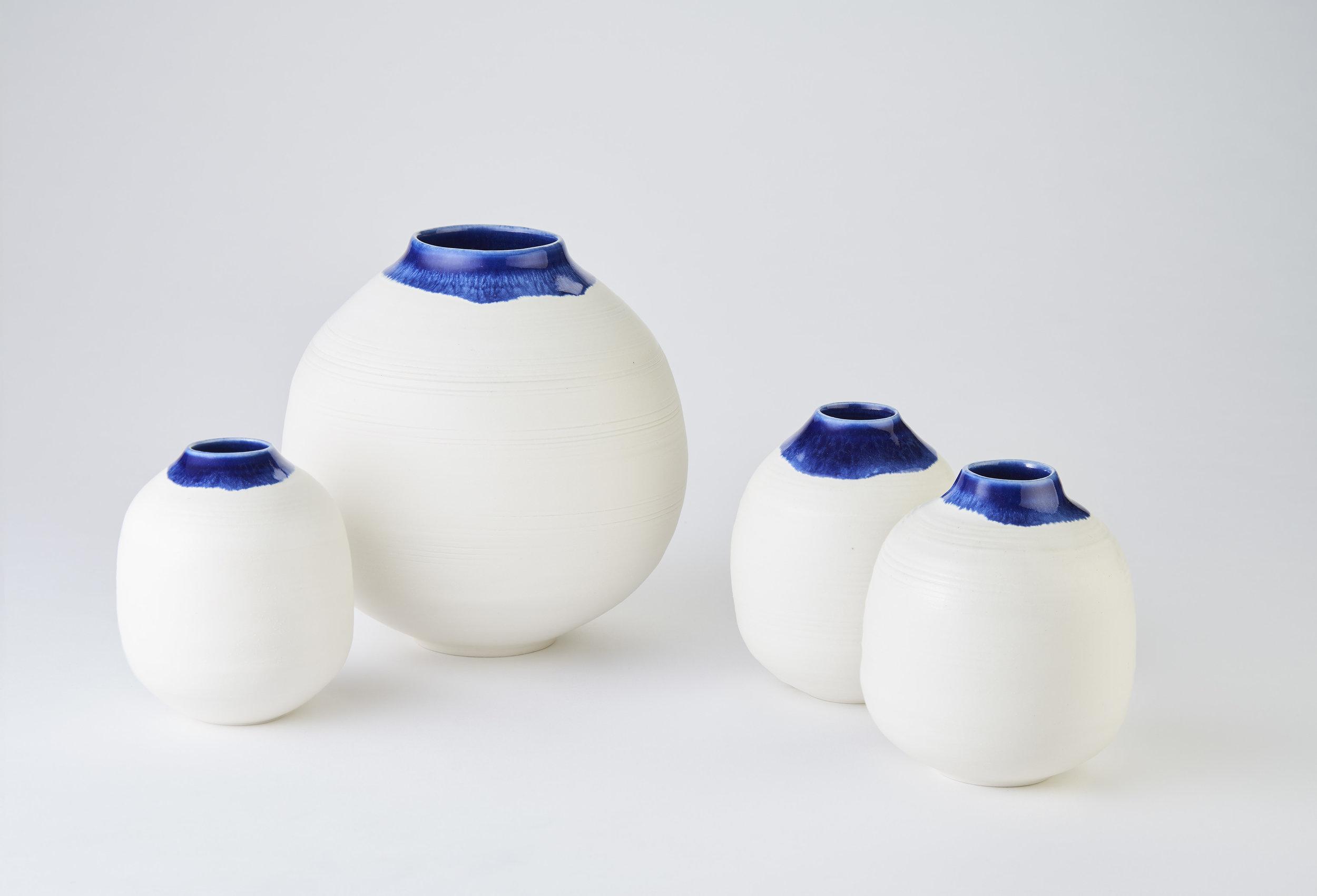 KA Ceramics Porcelain medium (5.5cm x 17cm) and small (3cm x 11cm) moon jars with blue inside and blue:dol and tin on rim 5.5cm x 17cm. Matthew Booth Photography.jpg