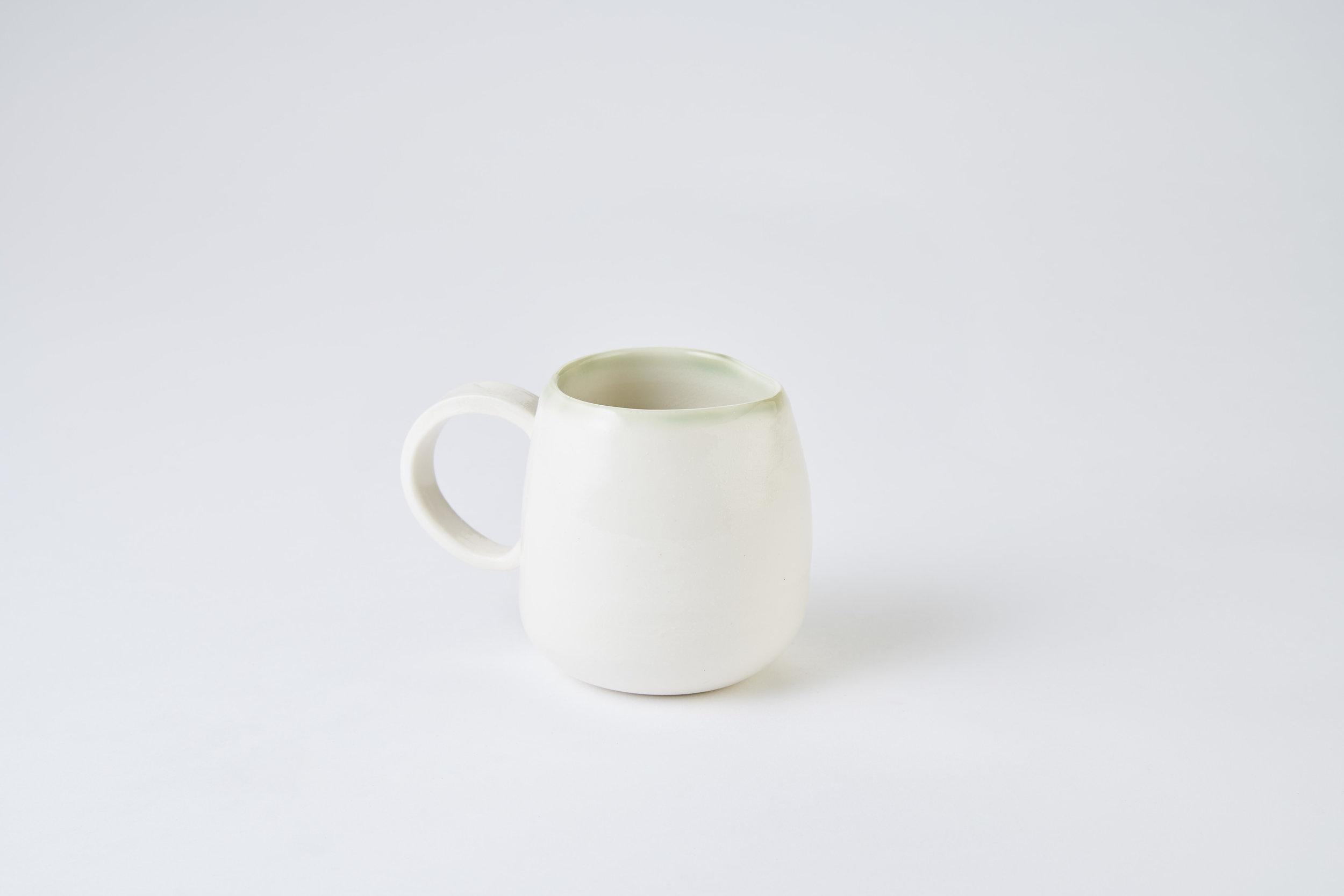 KA Ceramics copper green rim jug with handle. Matthew Booth Photography.jpg