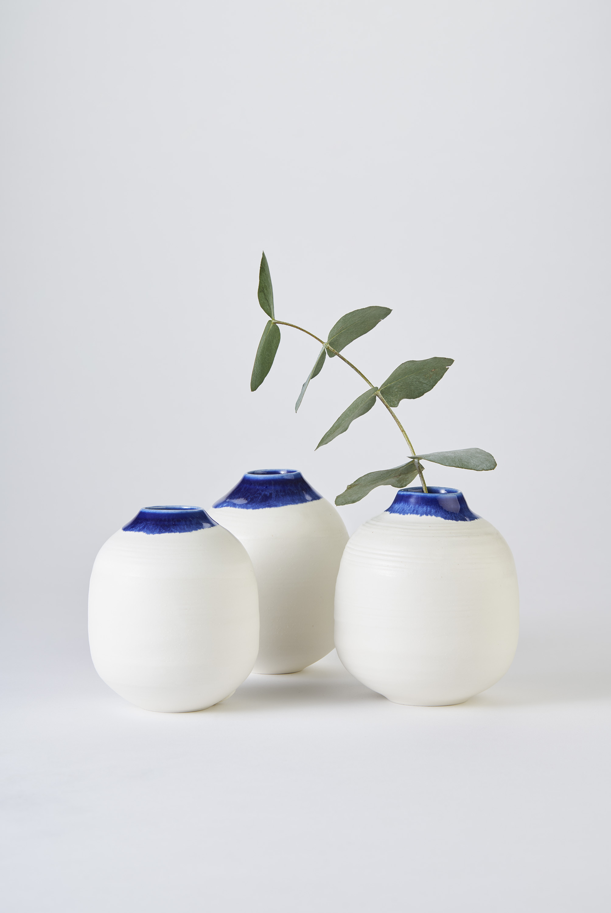 KA Ceramics Porcelain small moon jars with blue inside and blue:dol and tin on rim 3cm x 11cm. Matthew Booth Photography 1.jpg