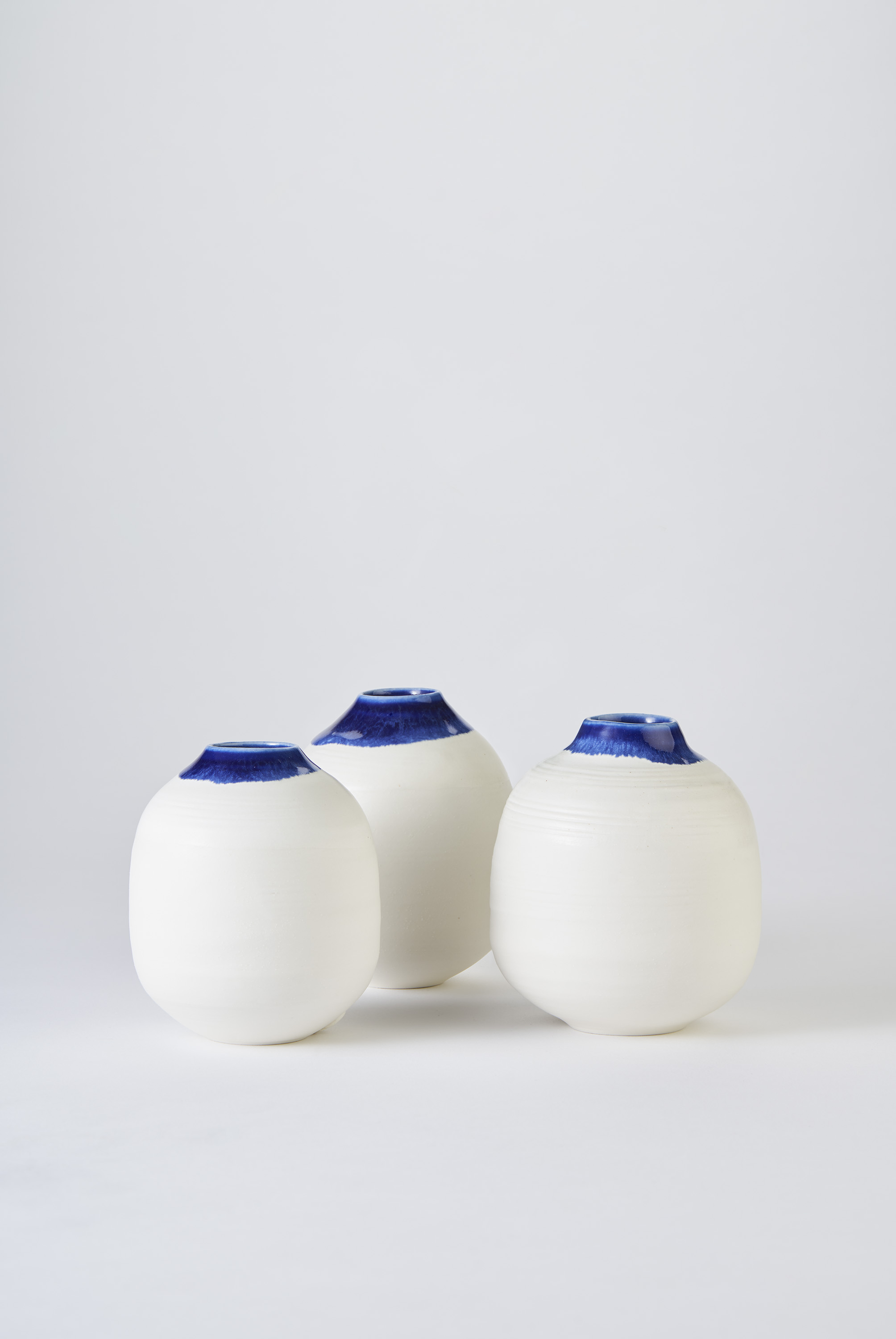 KA Ceramics Porcelain small moon jars with blue inside and blue:dol and tin on rim 3cm x 11cm. Matthew Booth Photography.jpg