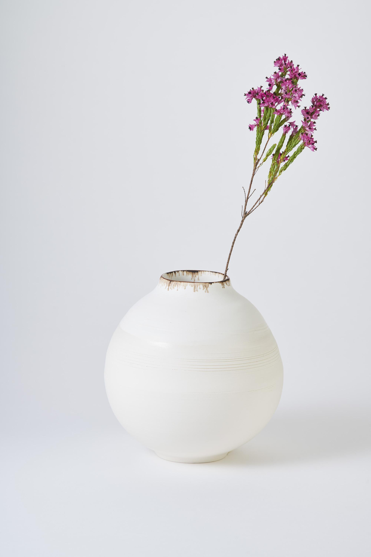 KA Ceramics Porcelain moon jar, dolomite and tin, bronze and oxide rim. Medium 6cm x 18cm. Matthew Booth Photography.jpg