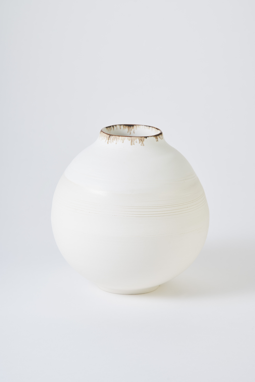 KA Ceramics Porcelain moon jar, dolomite and tin, bronze and oxide rim. Medium 6cm x 18cm. Matthew Booth Photography.jpg .jpg