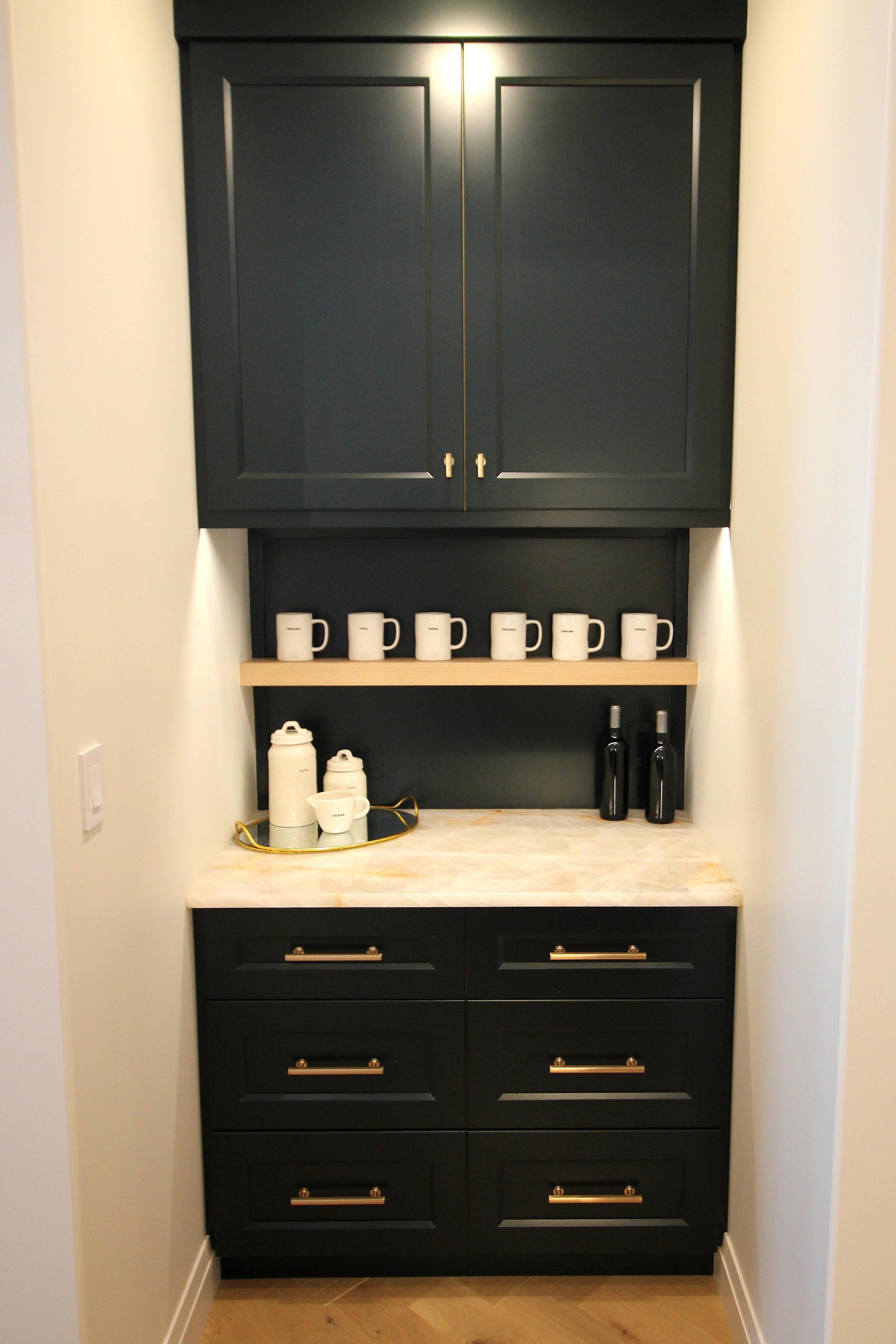 Benjamin Moore Black Forest Green cabinets, white oak, quartzite