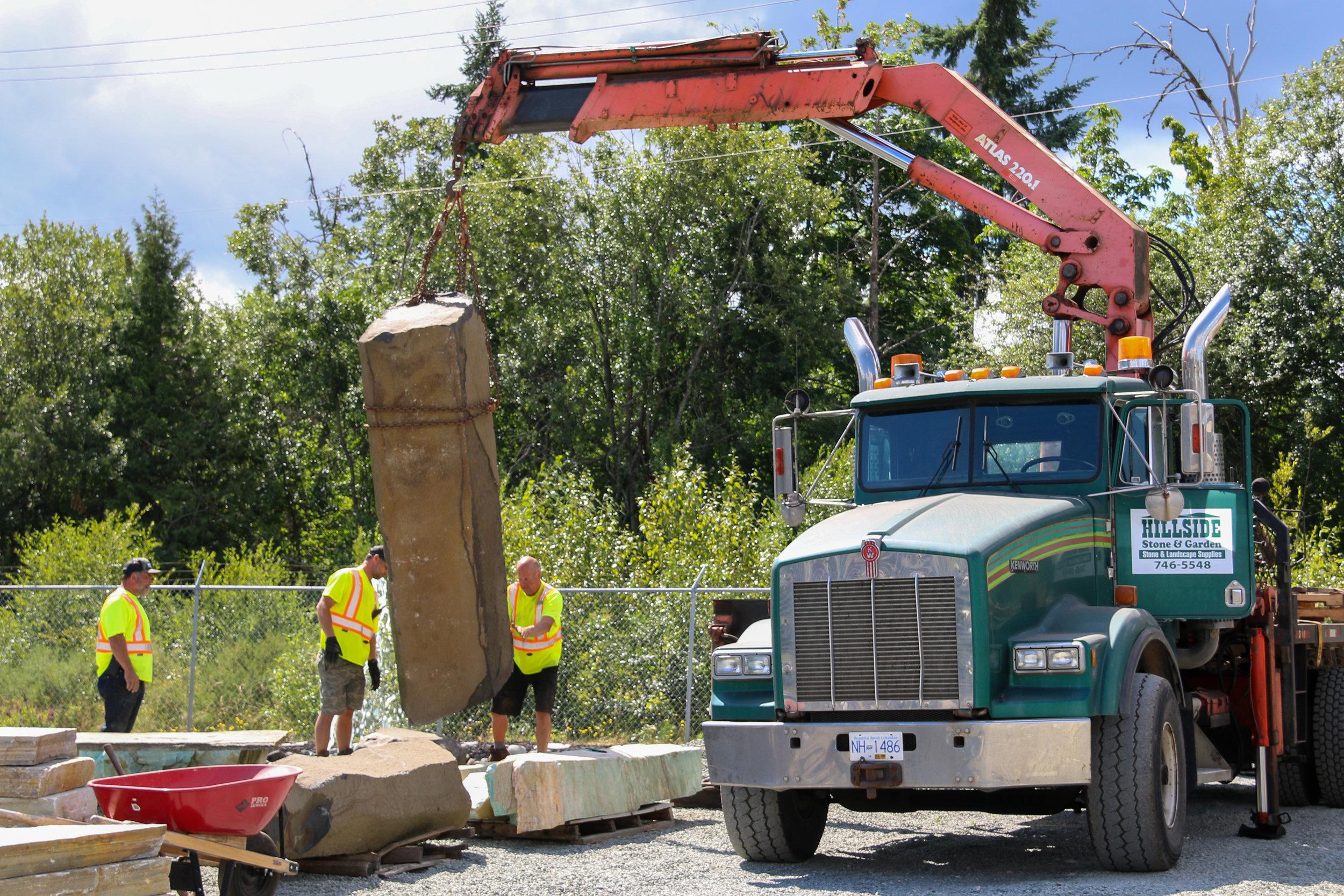 Crane Truck Delivery Hillside Stone and Garden