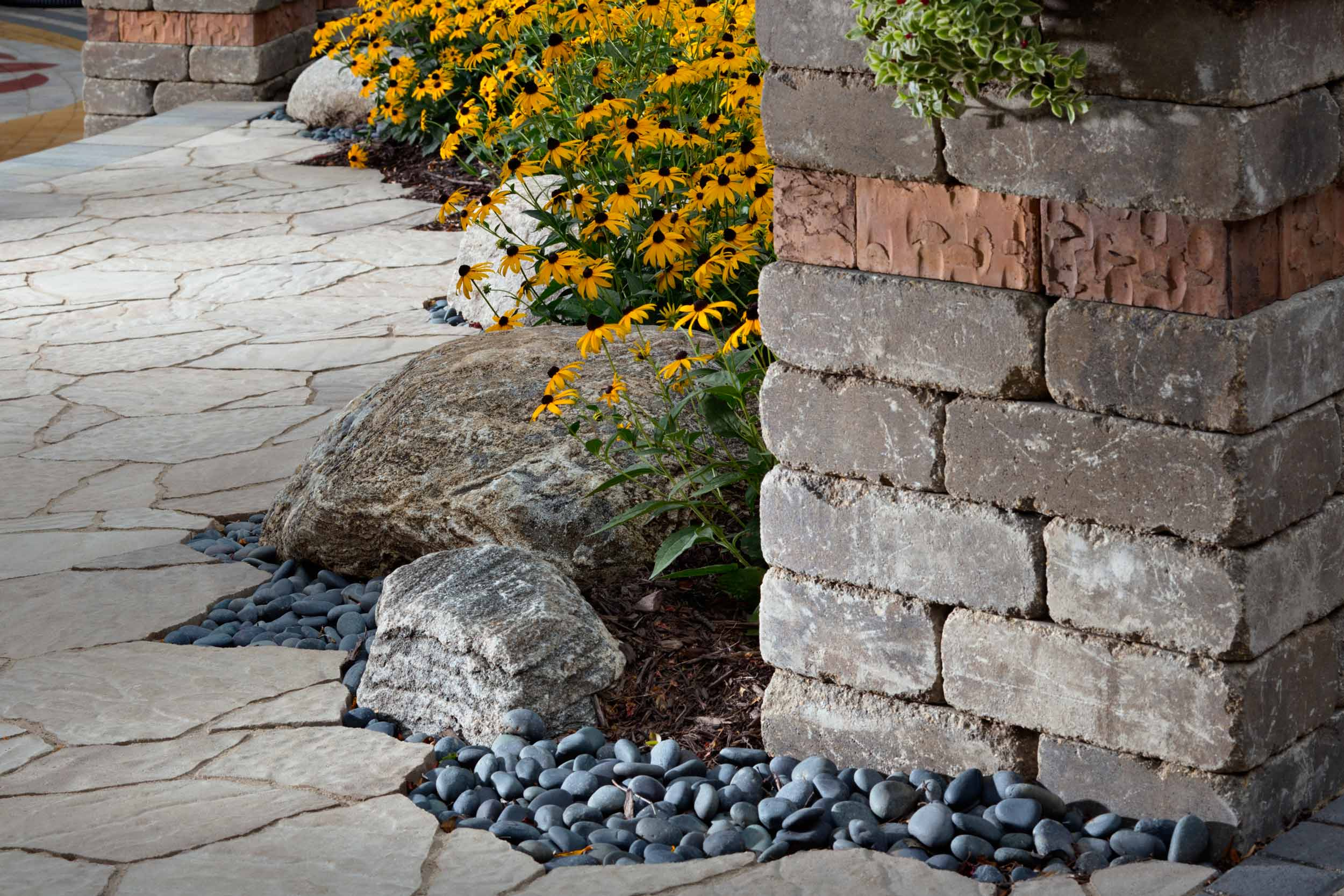 Using Concrete Pavers with pea stone for a walkway.