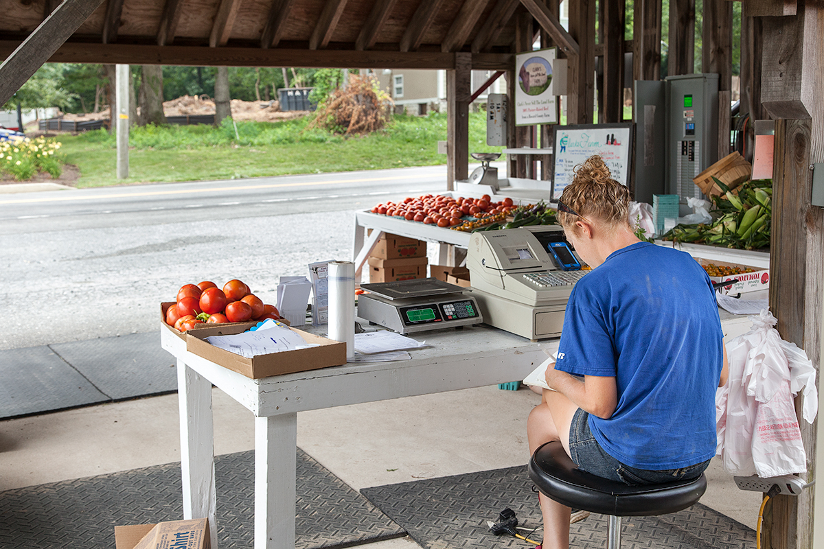 Nora waits for customers at the family farm stand
