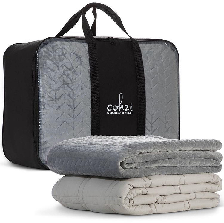 """$94.00    Cohzi  Weighted Blankets. Be Comfortable , Be Relaxed , Be Snug … Be Cohzi  Cohzi isn't just a luxury line of bedding; these deep touch sensory blankets mean SO much more than just being something to sleep with. Cohzi believes that your bedroom should be where you feel your safest, where you feel the most protected and comfortable. Suffering may be an unavoidable part of the human condition, but they are slowly trying to change that, one blanket at a time.   Product Details: (1) Removable, Quilted Polyester Duvet Cover with Zipper, (1) 100% Cotton Inner Gravity Sleep Blanket with Glass Beads, (1) Storage and Transportation Bag. Size Variations: 60"""" x 80"""" - 20 lb, 48"""" x 78"""" - 15 lb, 41"""" x 60"""" - 10 lb. This product is non-toxic, breathable, hypoallergenic, machine-washable cover."""