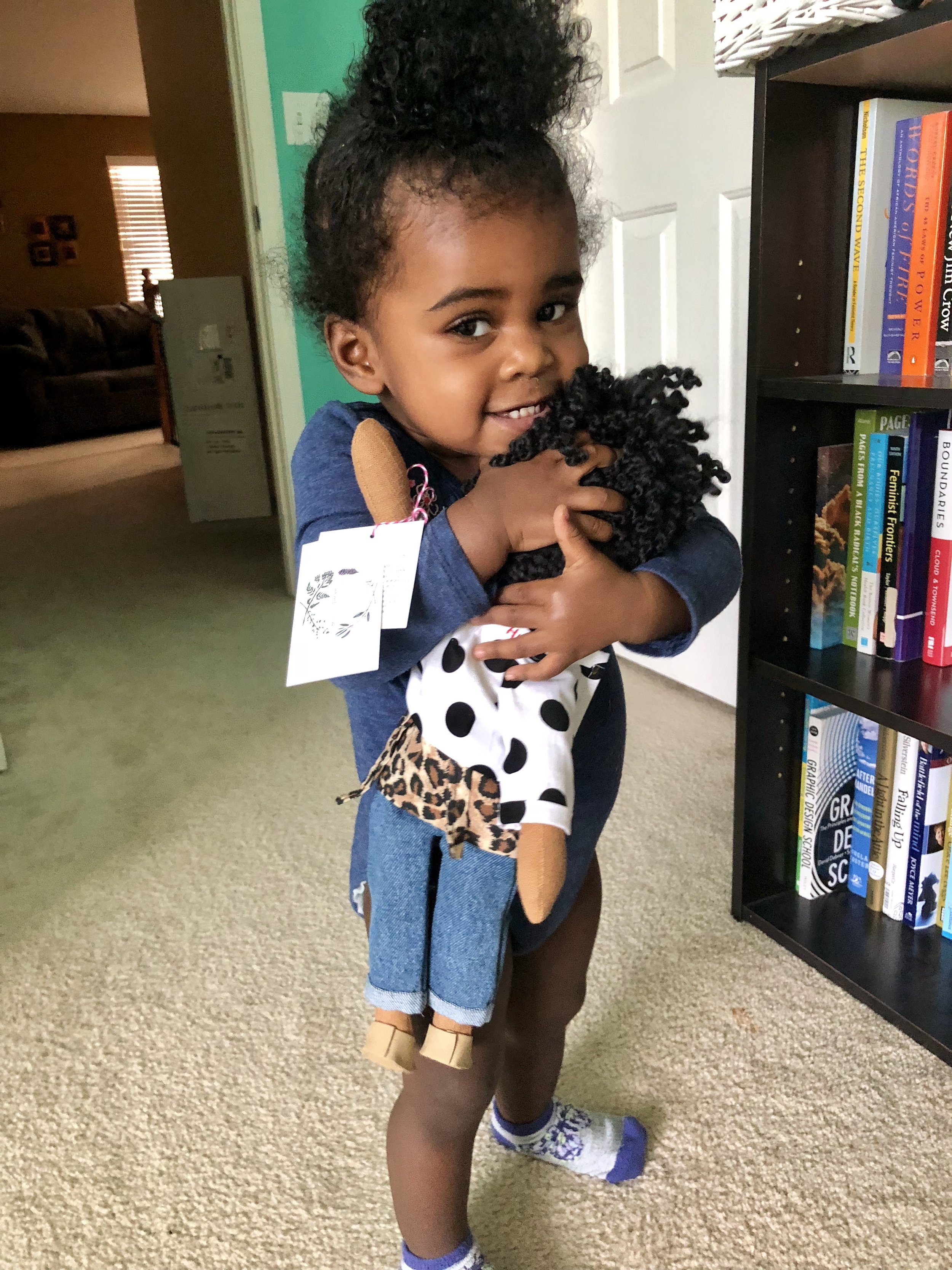 Zion and her  Harper Iman  doll