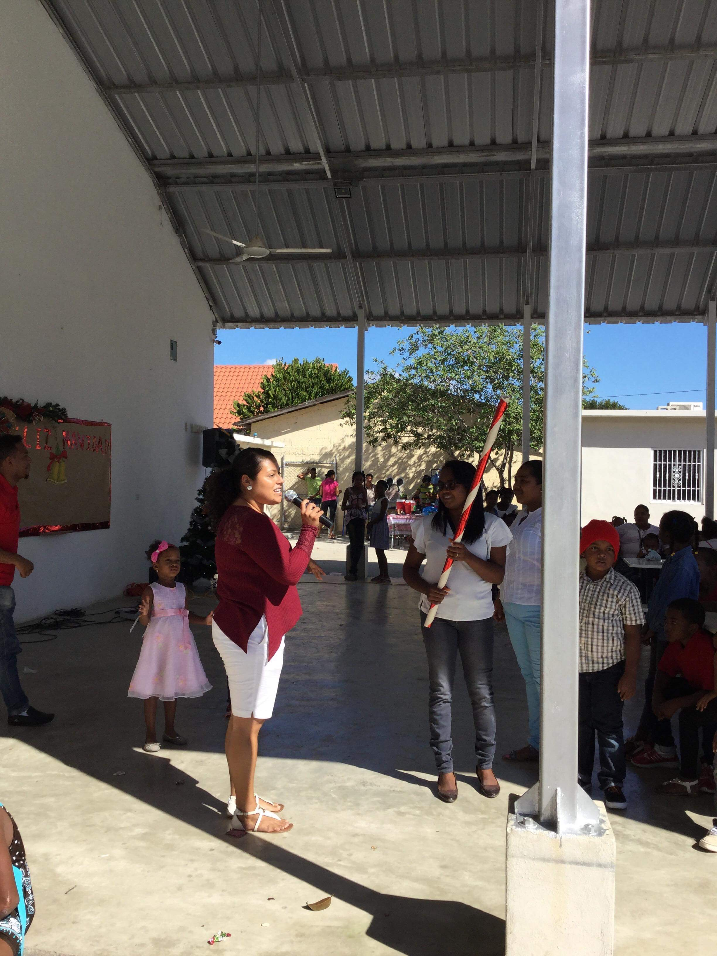 Zaira shares her Mexican culture with the school by showing them how to break the piñata.