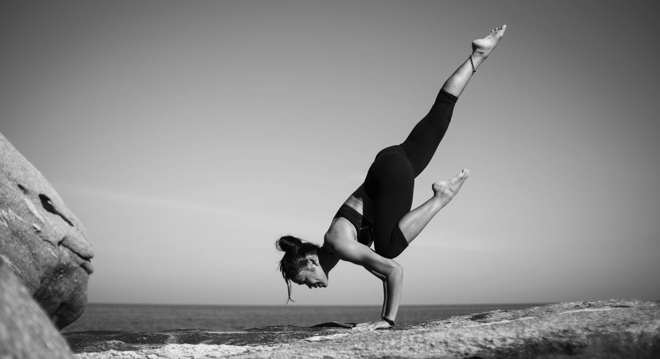 MRL Retreat Girl in yoga pose by beach BW.jpg