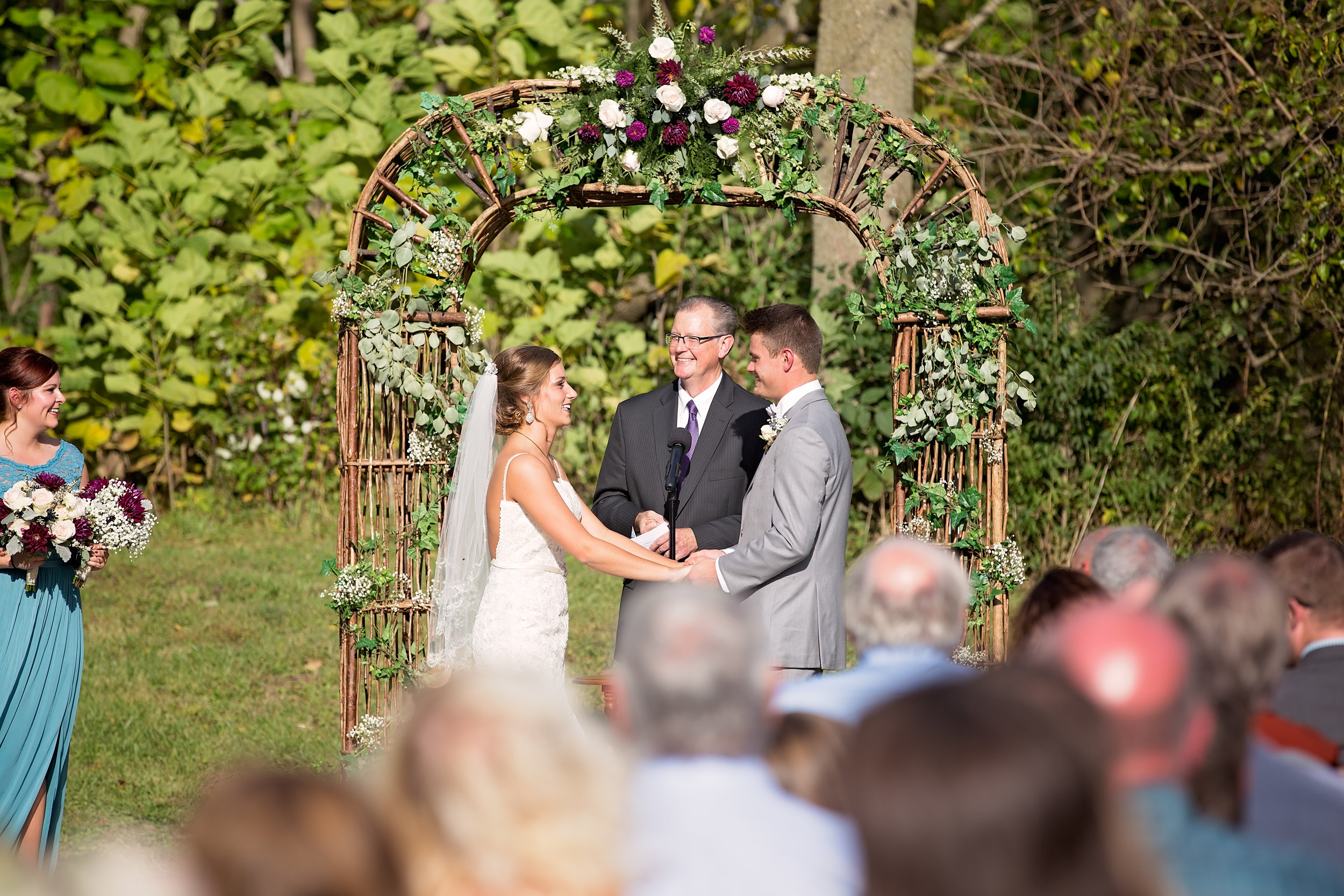 bride and groom saying vows at ceremony
