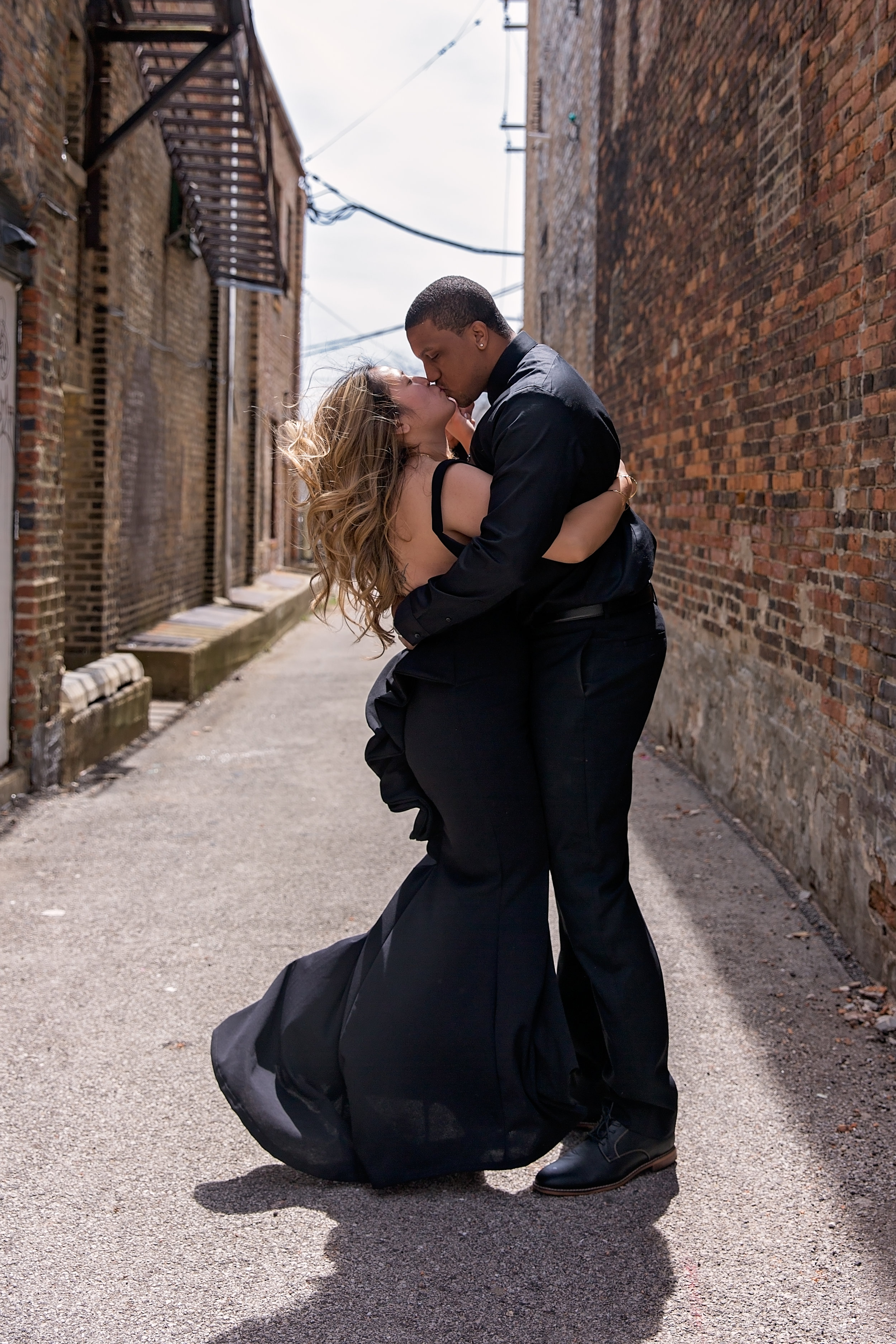 husband and wife kissing during couples session