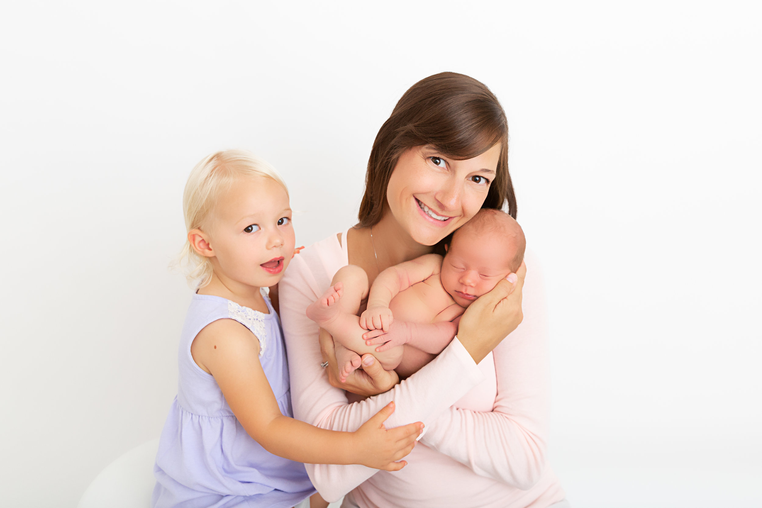 mommy with new baby and big sister