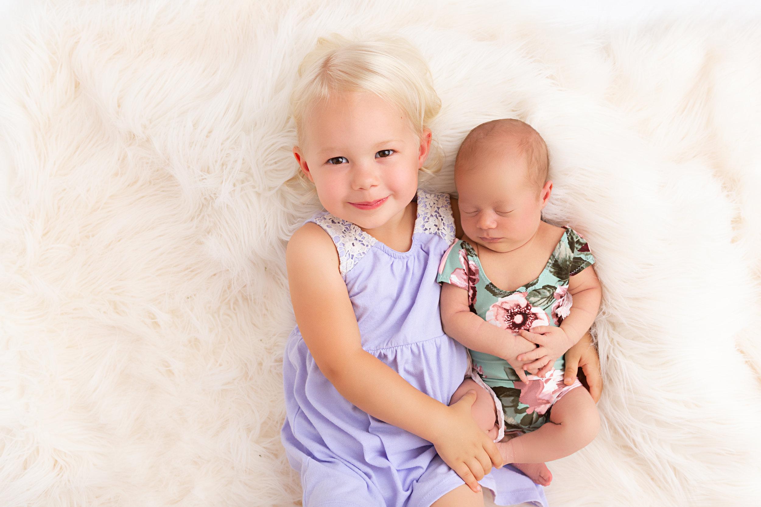 newborn baby and big sister