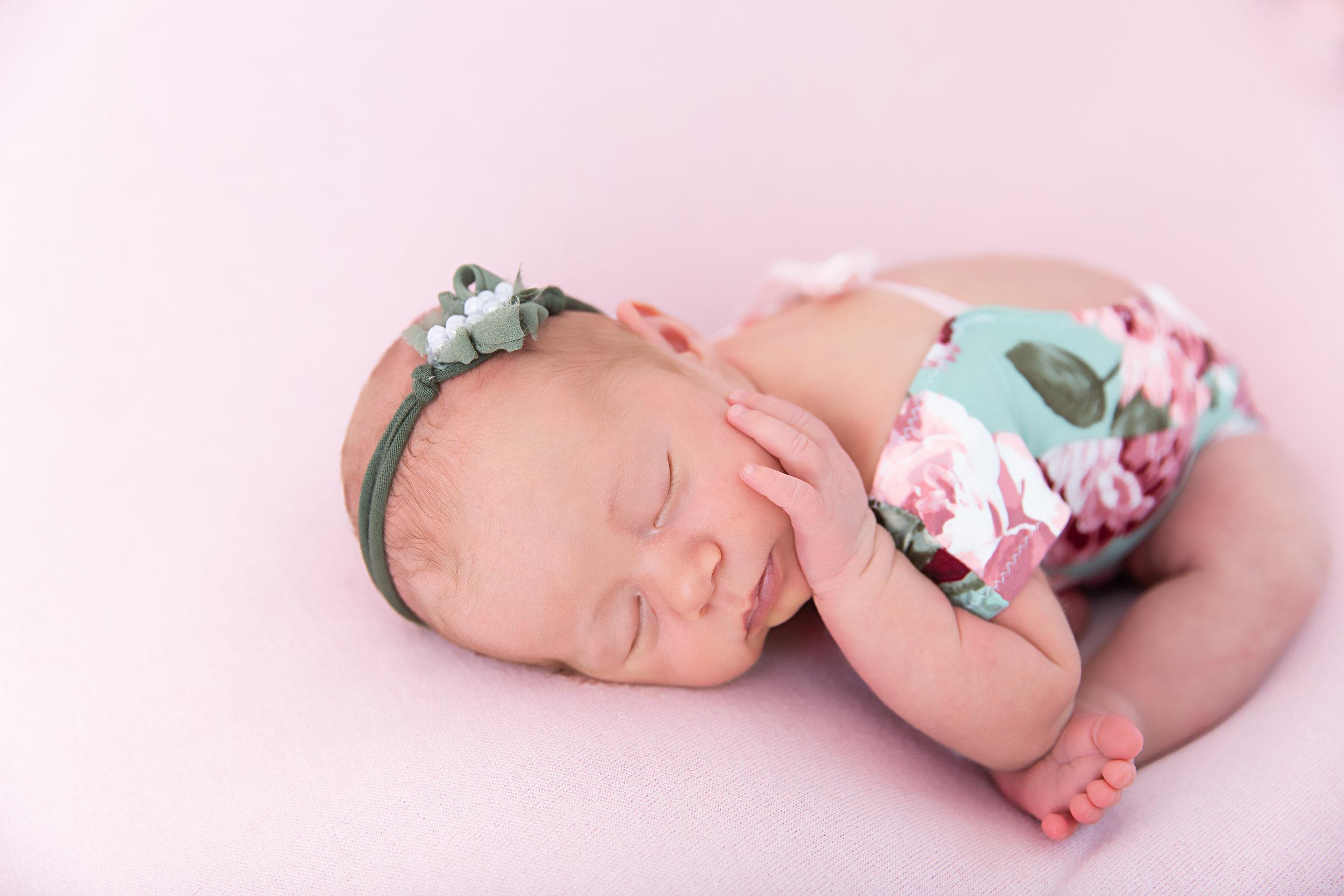 posed sleeping newborn baby