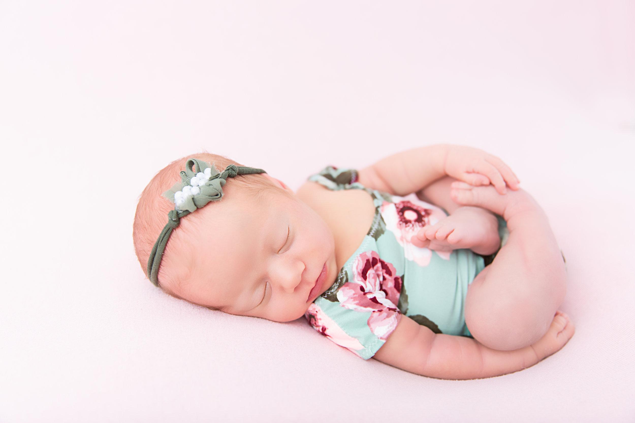 posed newborn baby sleeping