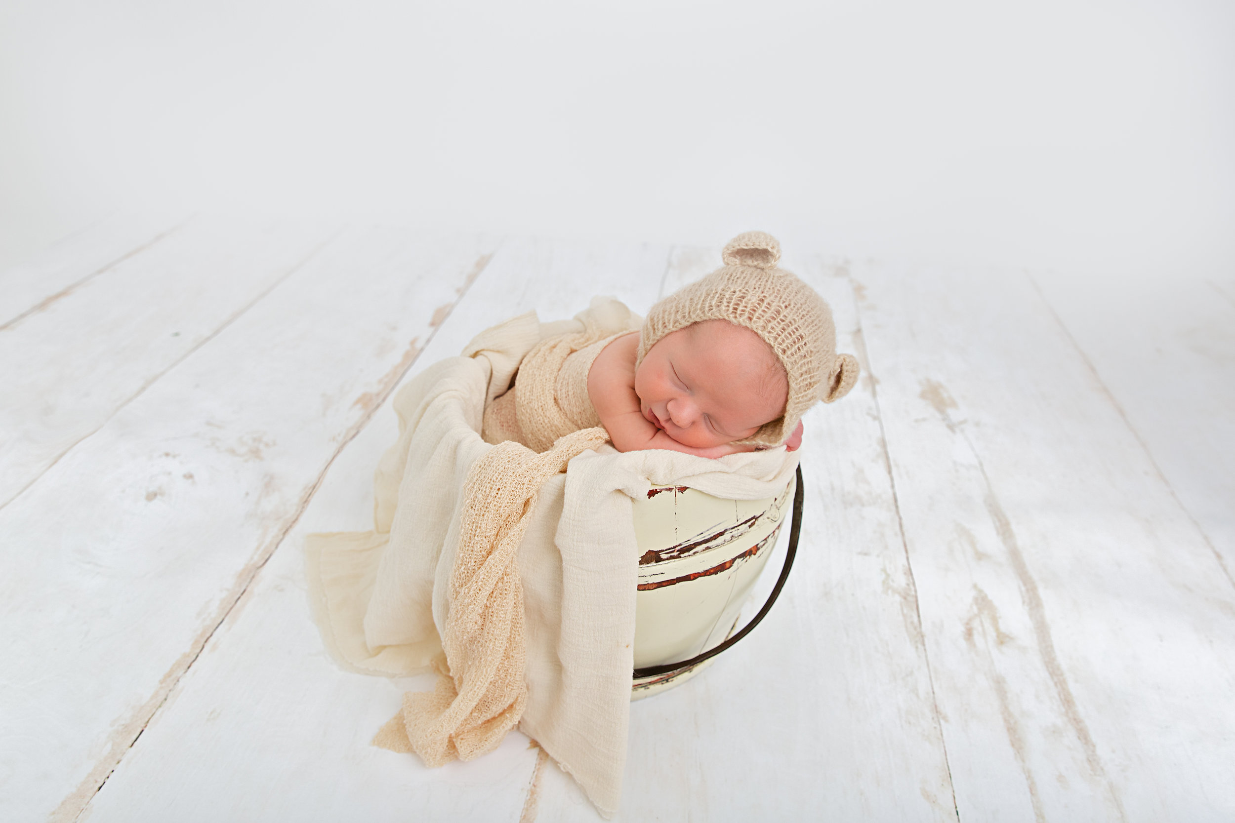 newborn baby in prop pose