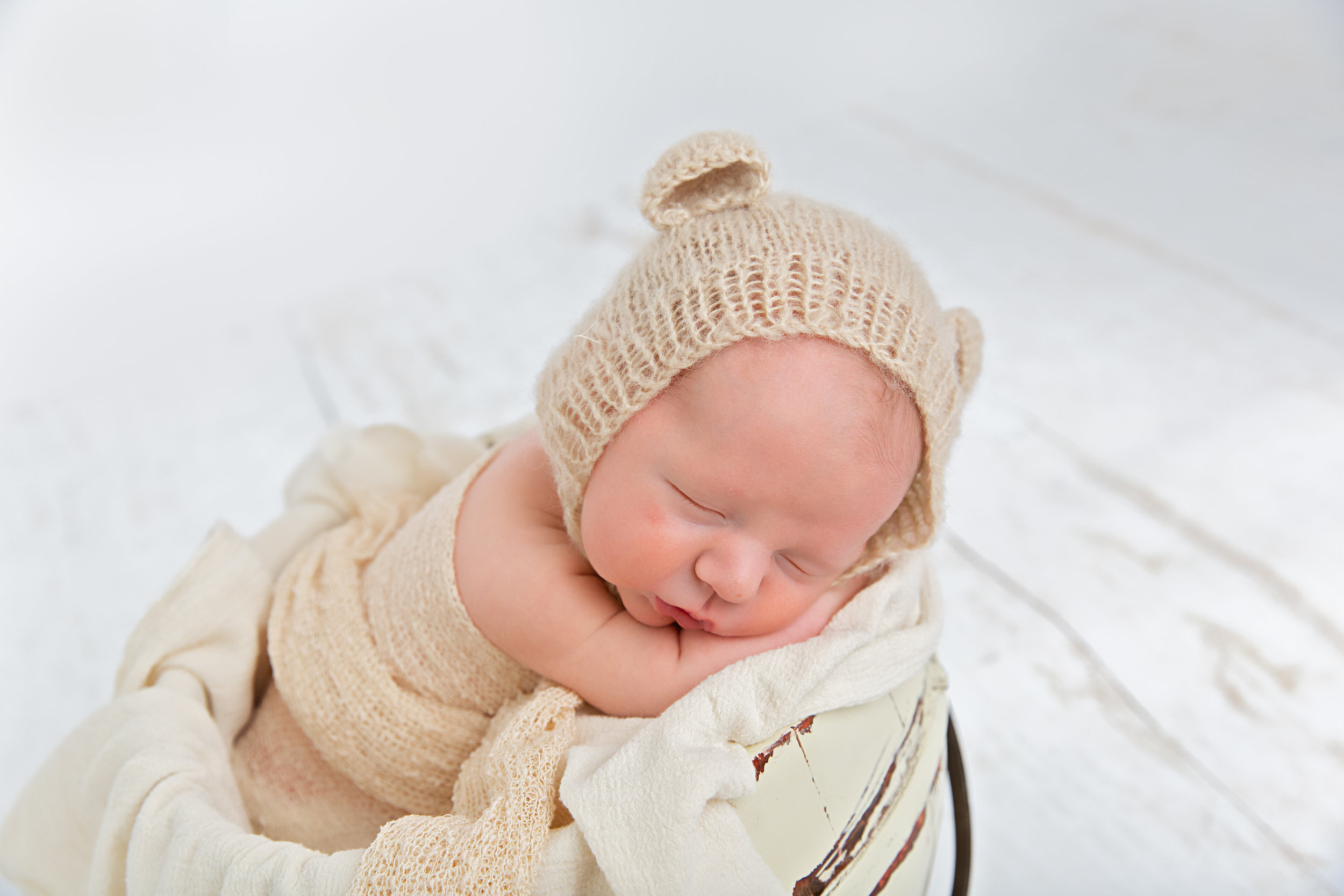 newborn baby sleeping in prop pose