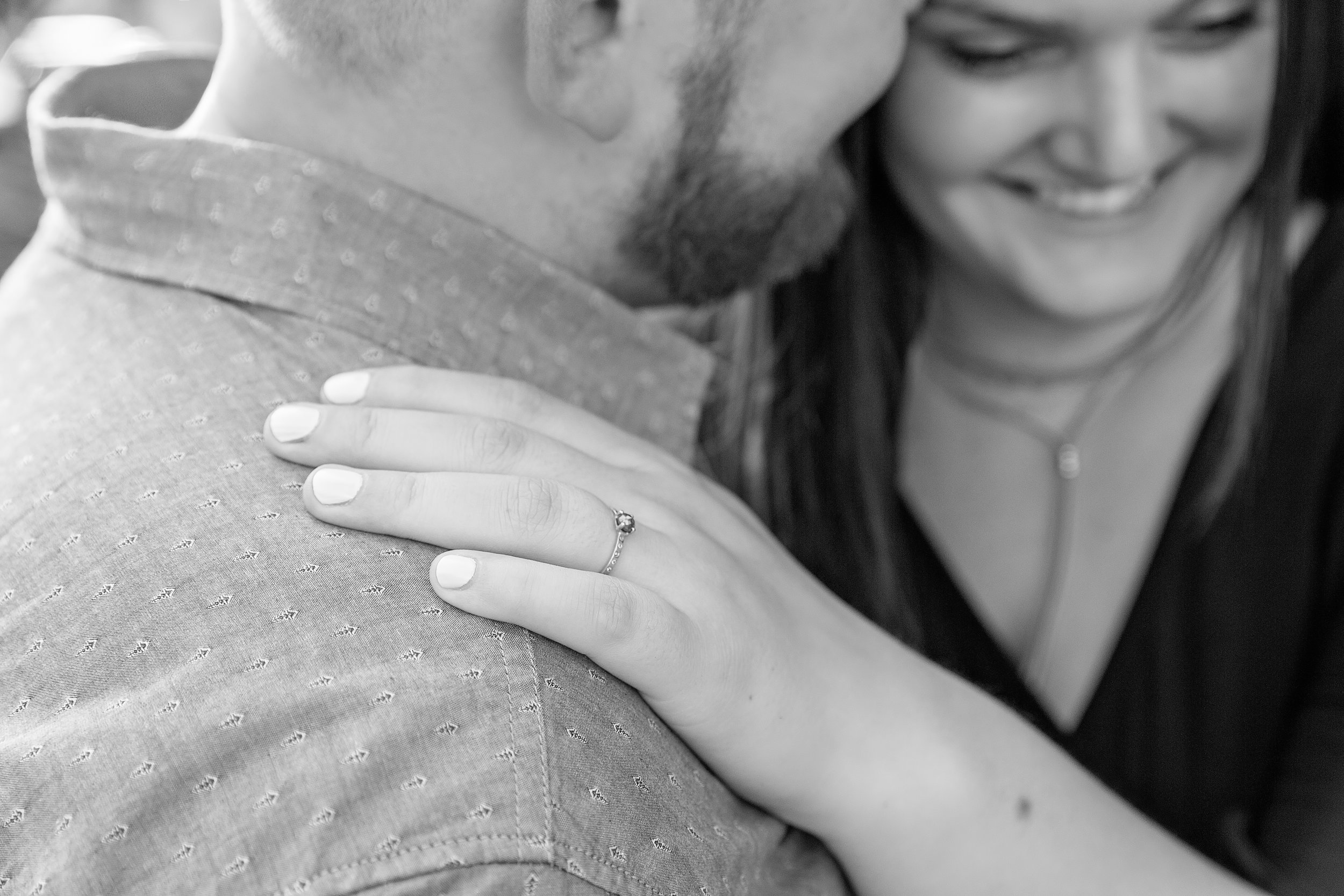 close up of engagement ring in black and white image