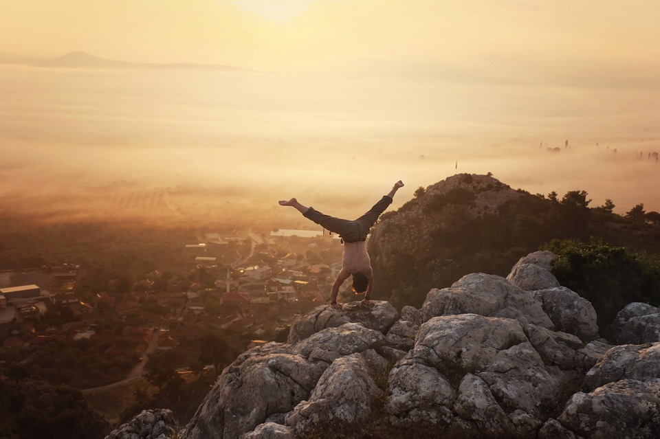 Person on mountain handstand. (Getty Images)