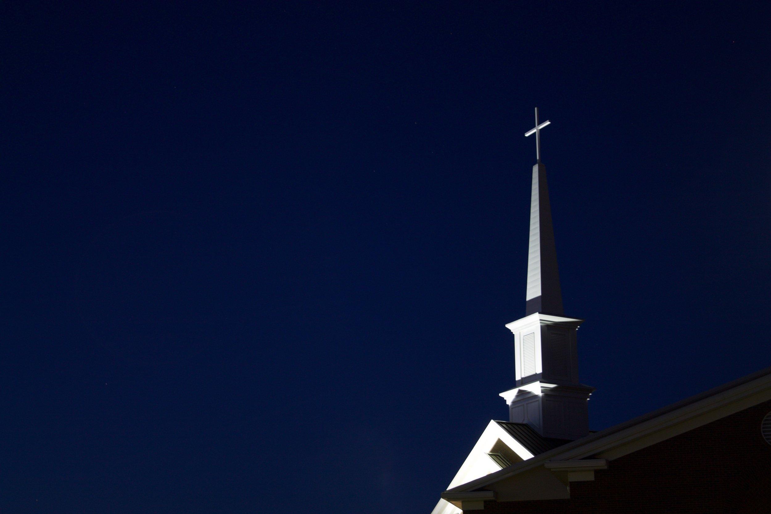 Texas Church Steeple Illuminated at Night