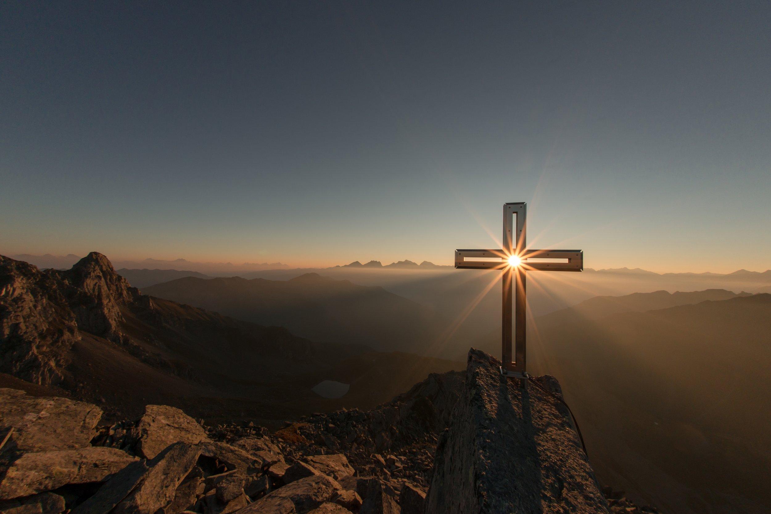 Cross on Mountaintop Sunset