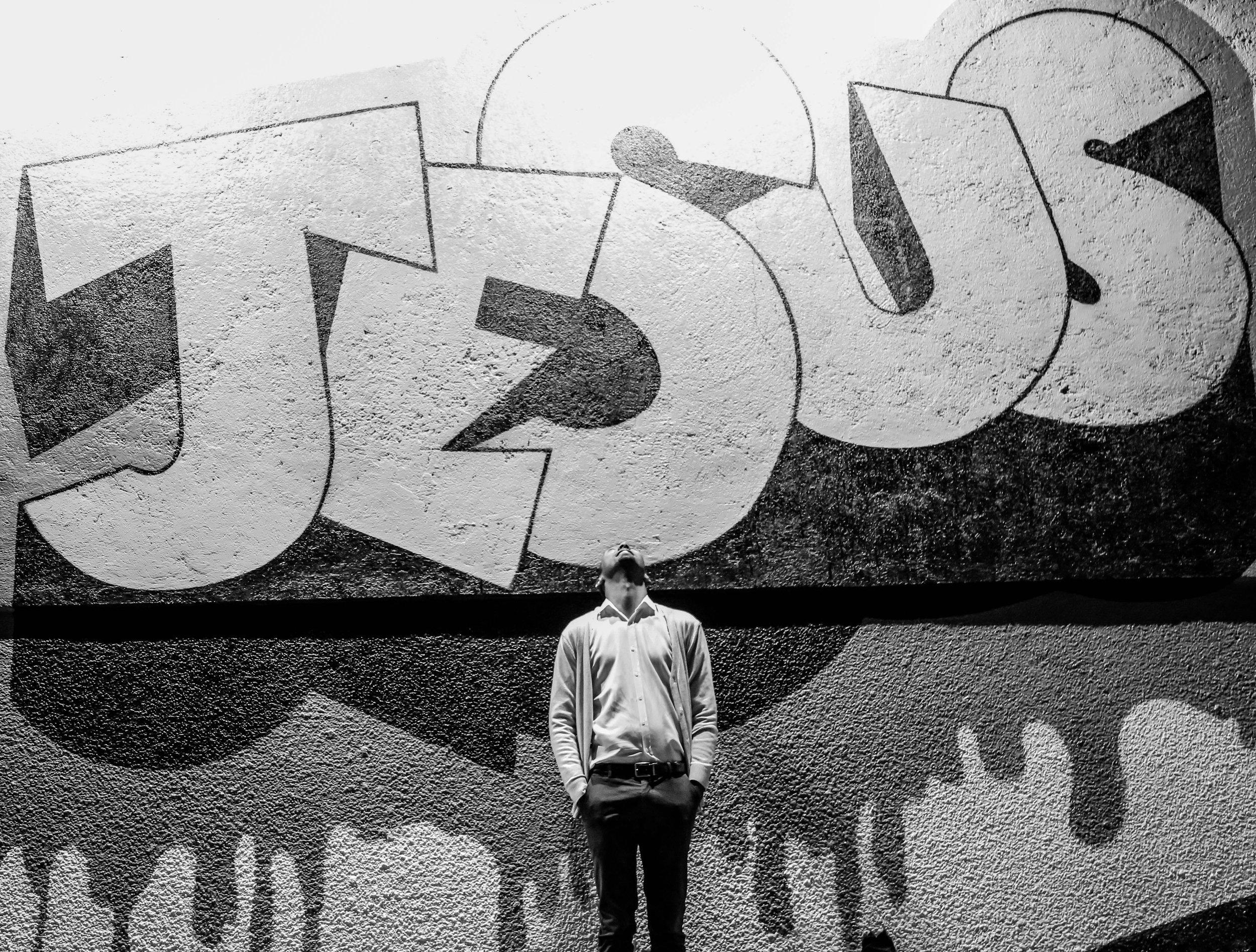 Young Man Looking Up at Jesus Graffiti