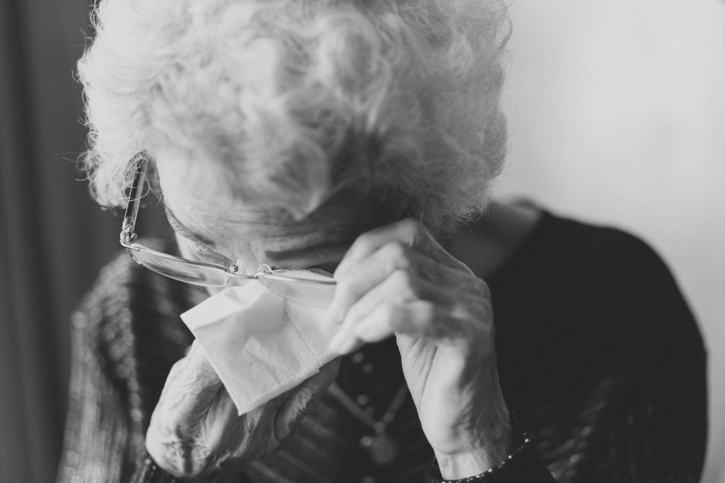 Elderly Woman Weeping